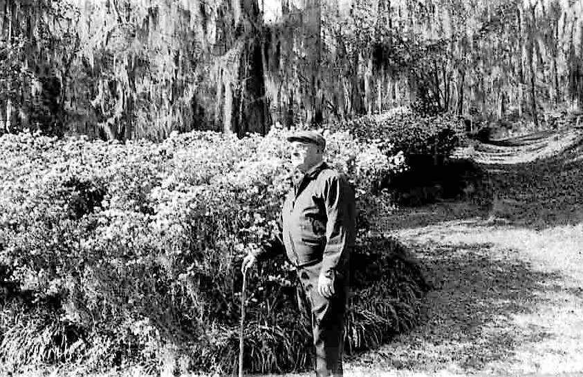 Dr. J.R. Dunn is seen taking one of his many walks through Dunndell Gardens in 1975.