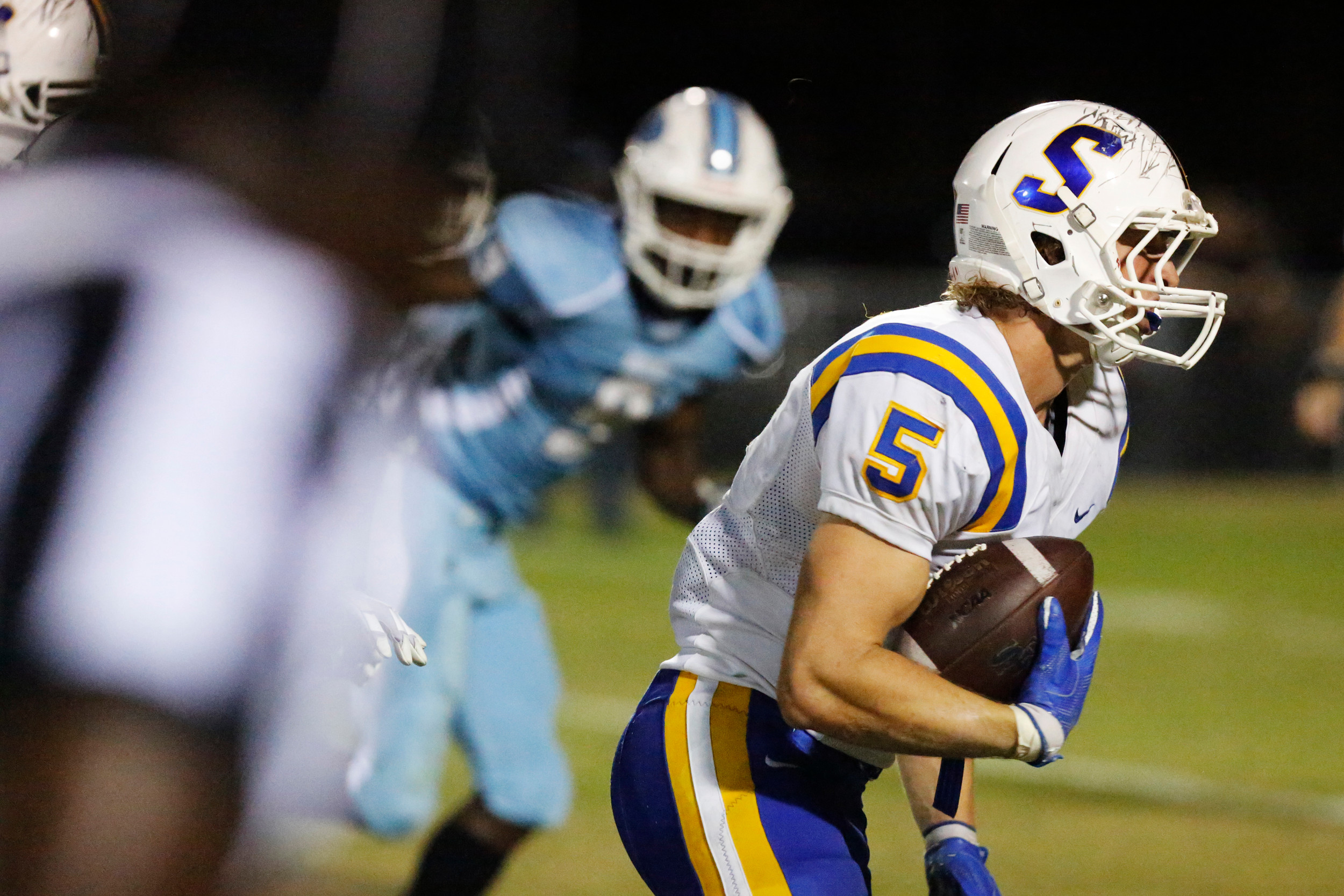 Sumter's Cooper Mota (5) returns a fumble 24 yards for a touchdown during the Gamecocks' 31-20 victory over South Florence on Friday at Florence's Memorial Stadium.