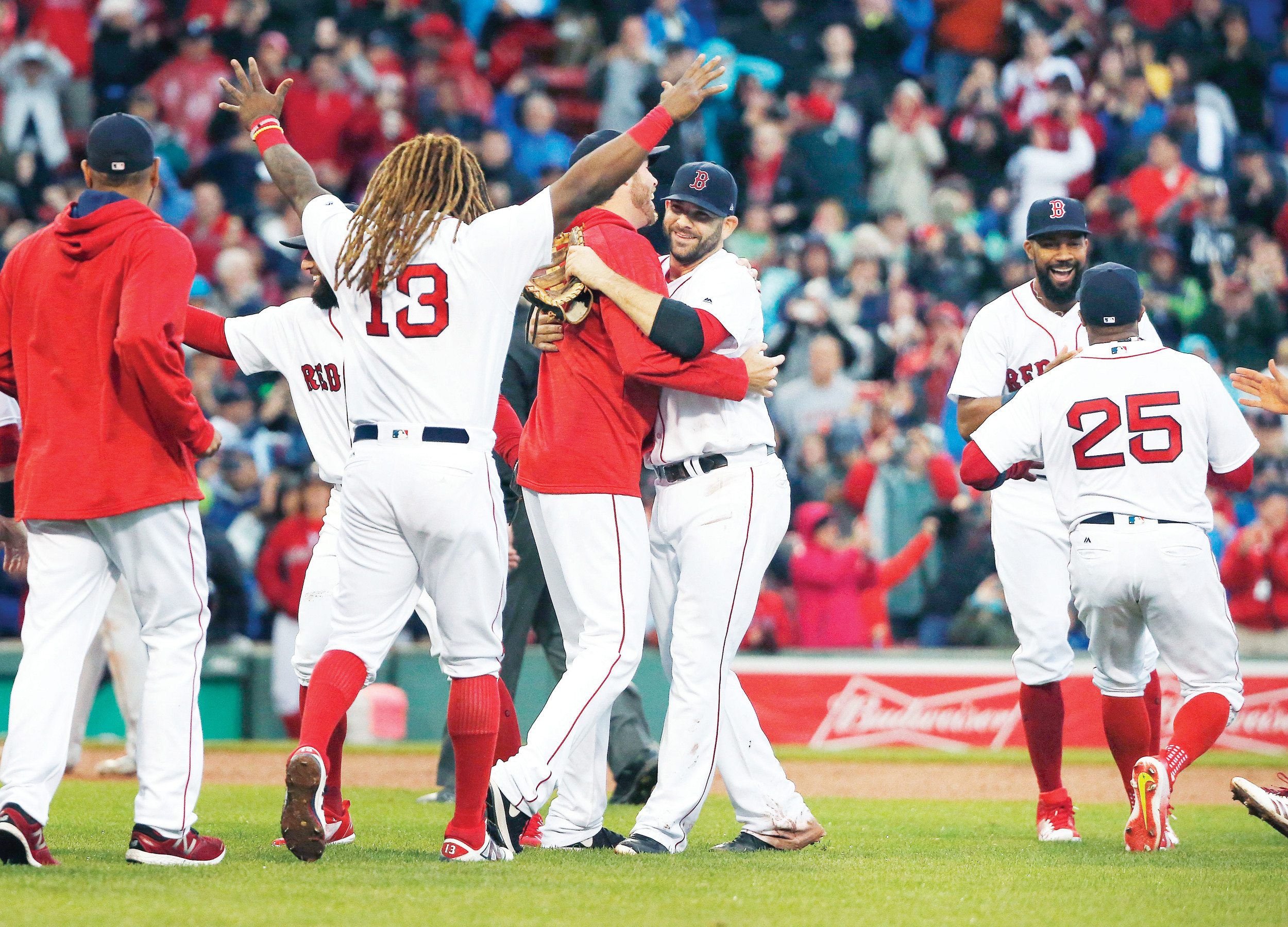 The Boston Red Sox celebrate after defeating the Houston Astros 6-3 on Saturday in Boston to clinch the American League East Division championship.