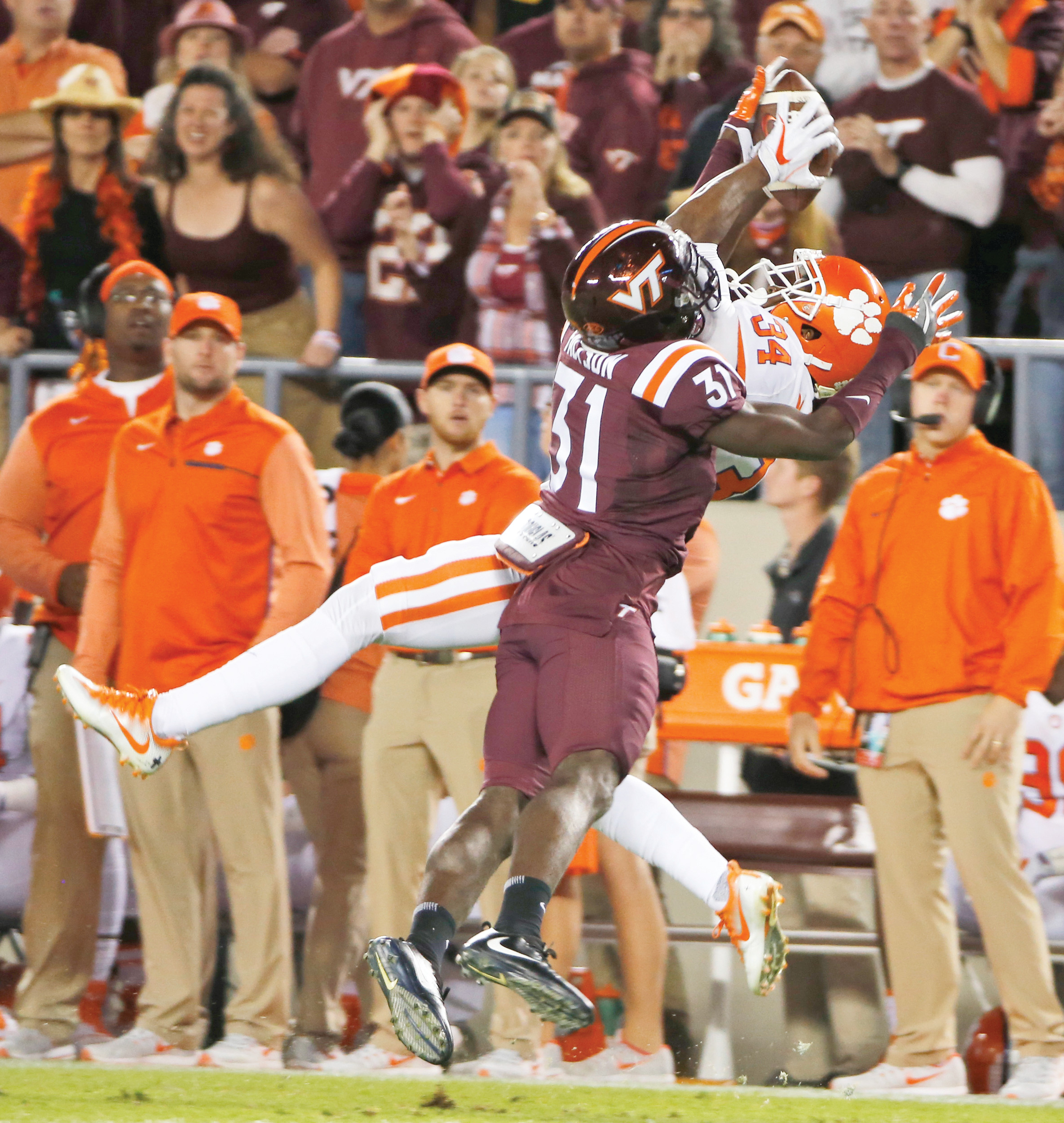Clemson wide receiver Ray-Ray McCloud (34) grabs a pass as Virginia Tech cornerback Brandon Facyson (31) defends during the Tigers' 31-17 victory on Saturday in Blacksburg, Va.