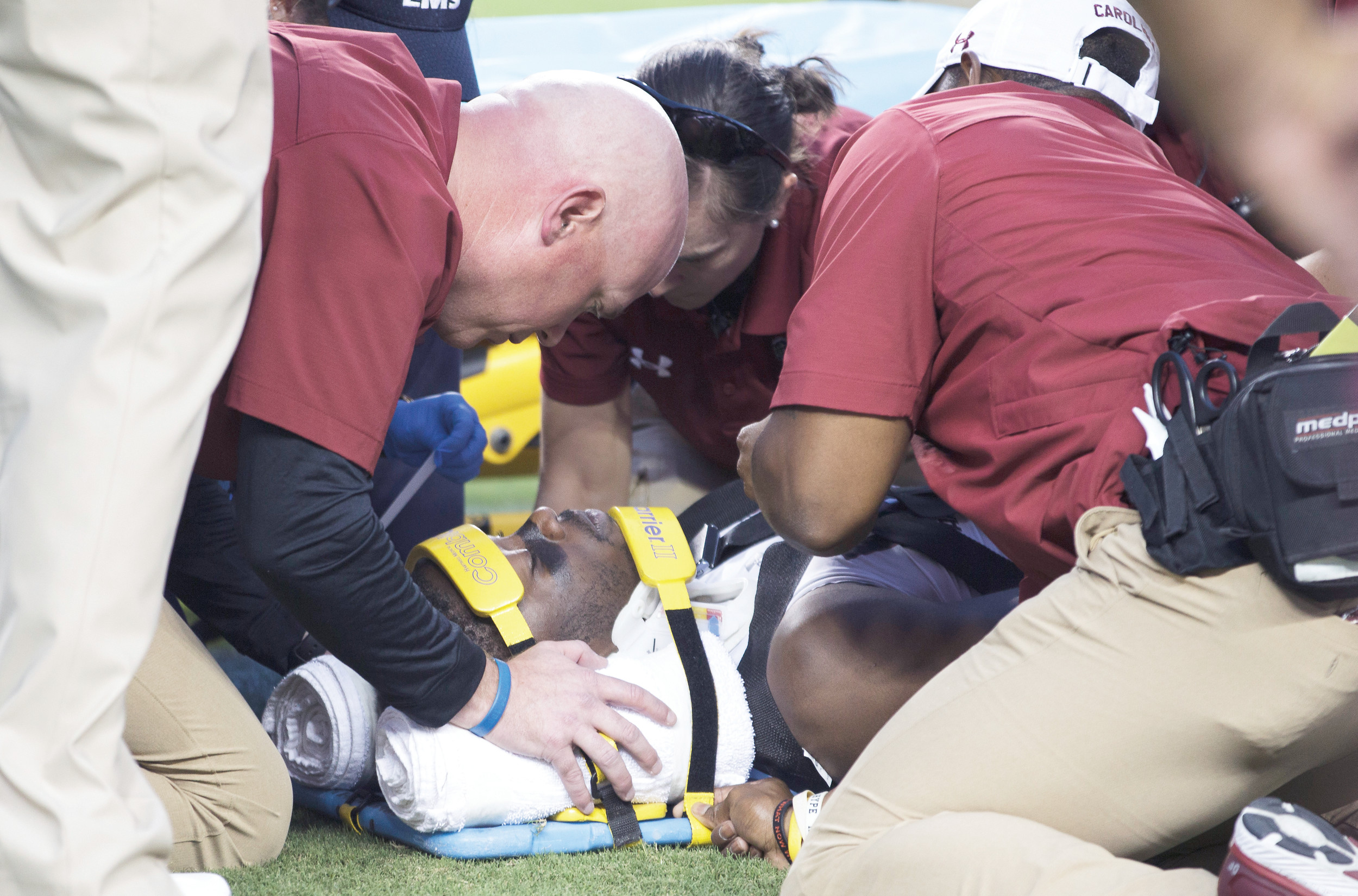South Carolina wide receiver Terry Googer (6) is looked over by medical personal after being injured during the first quarter Saturday's game in College Station, Texas. Googer did have feeling in all of his extremities and was released from the hospital.