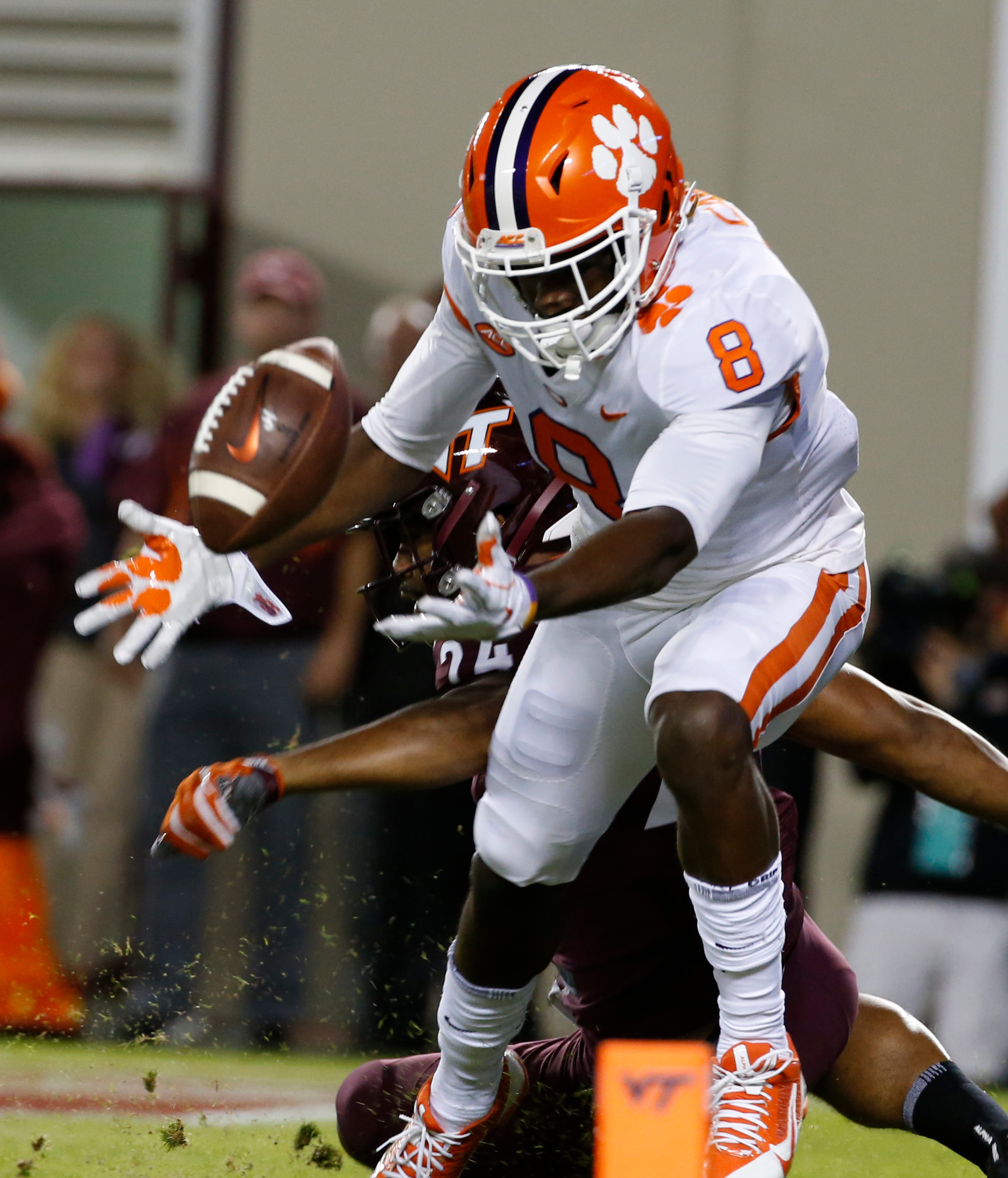 Clemson wide receiver Deon Cain (8) reaches for a pass in the end zone as Virginia Tech linebacker Anthony Shegog (24) defends during the Tigers' 31-17 victory on Saturday in Blacksburg, Va.