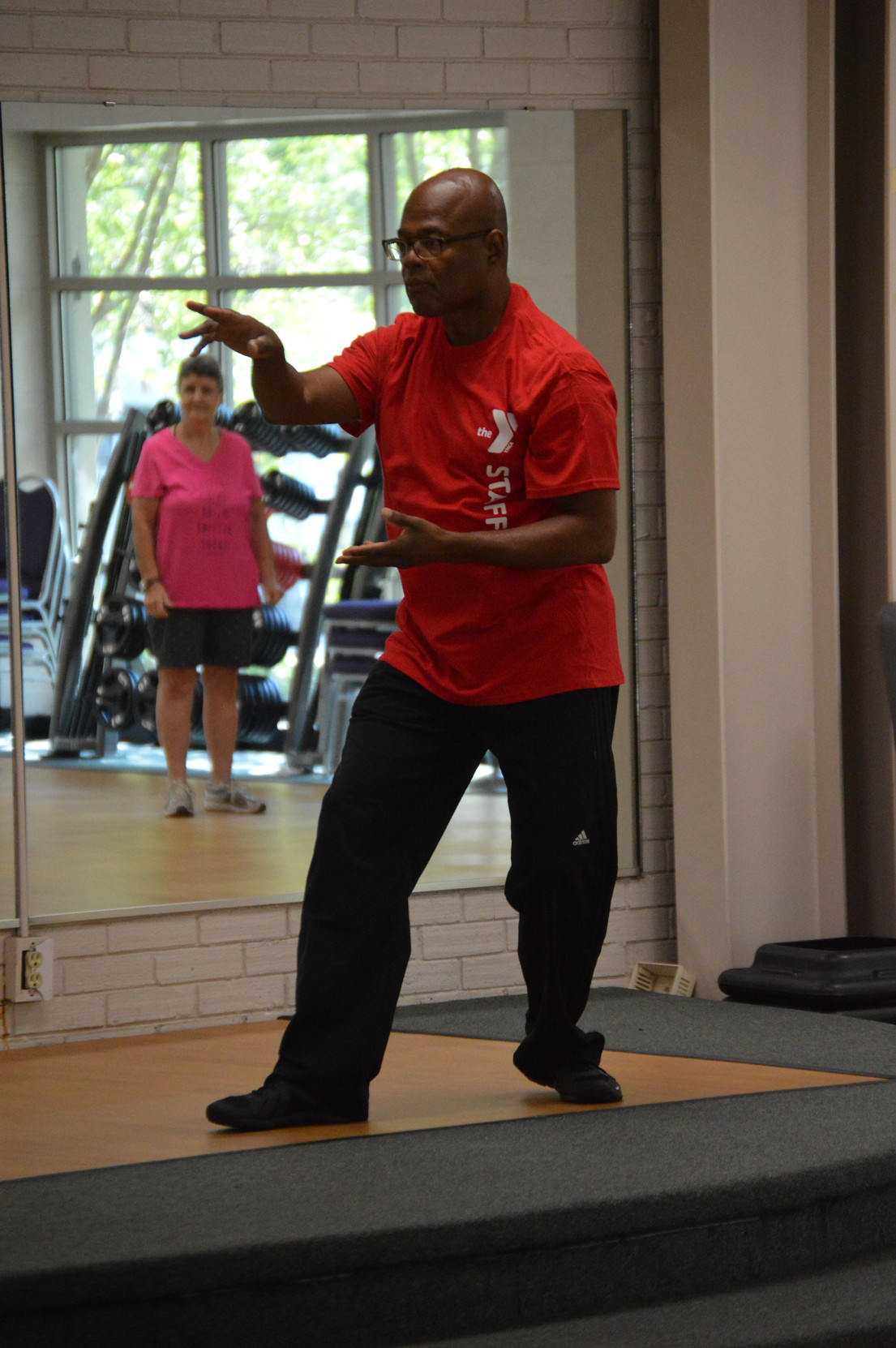 Joseph Whiting, director of health promotion, education and behavior at Phoenix Health Education and Wellness Center, shows his students Tai Chi movements during his Tai Chi class at Sumter Family YMCA on Friday.