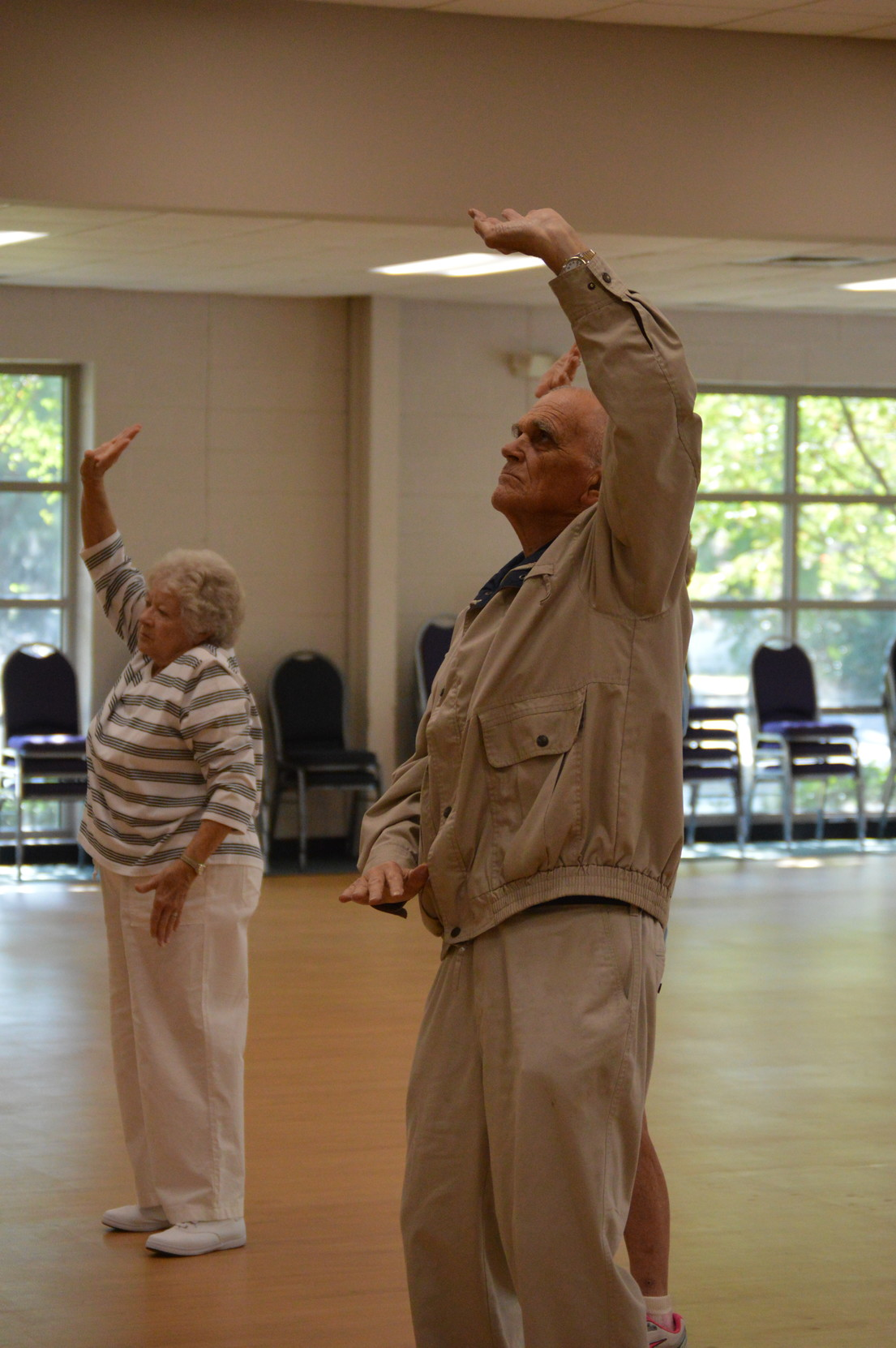 Students practice a Tai Chi breathing exercise during Joseph Whiting's Tai Chi class at Sumter Family YMCA on Friday.