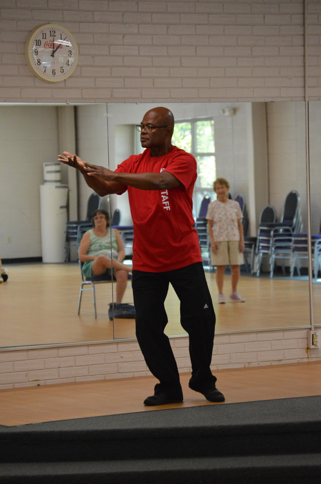 PHOTOS BY ADRIENNE SARVIS / THE SUMTER ITEMJoseph Whiting, director of health promotion, education and behavior at Phoenix Health Education and Wellness Center, shows his students Tai Chi movements during his Tai Chi class at Sumter Family YMCA on Friday.