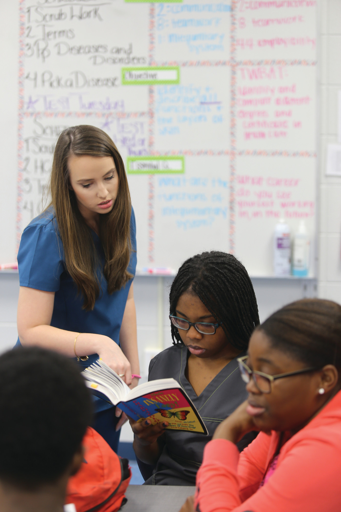 Sumter Career and Technology Center teacher Tiffany Morris goes over drug classifications from a textbook with Sumter High School senior Heather Brown on Friday as other students look on at the career and technology center.