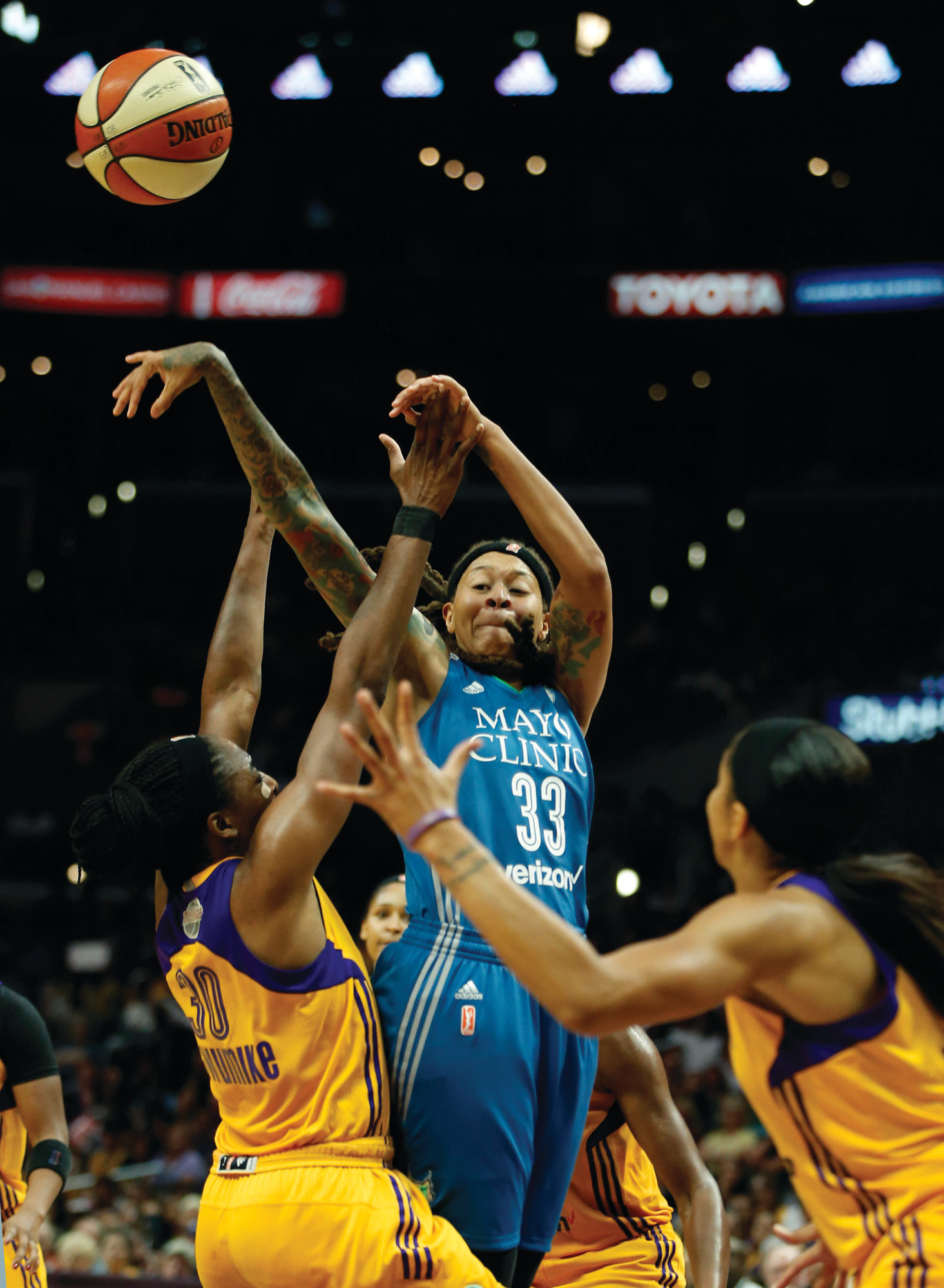 THE ASSOCIATED PRESSMinnesota guard Seimone Augustus, center, passes the ball over Los Angeles  forwards Nneka Ogwumike (30) and Candace Parker during the Lynx's 80-69 victory on Sunday in Game 4 of the WNBA Finals.