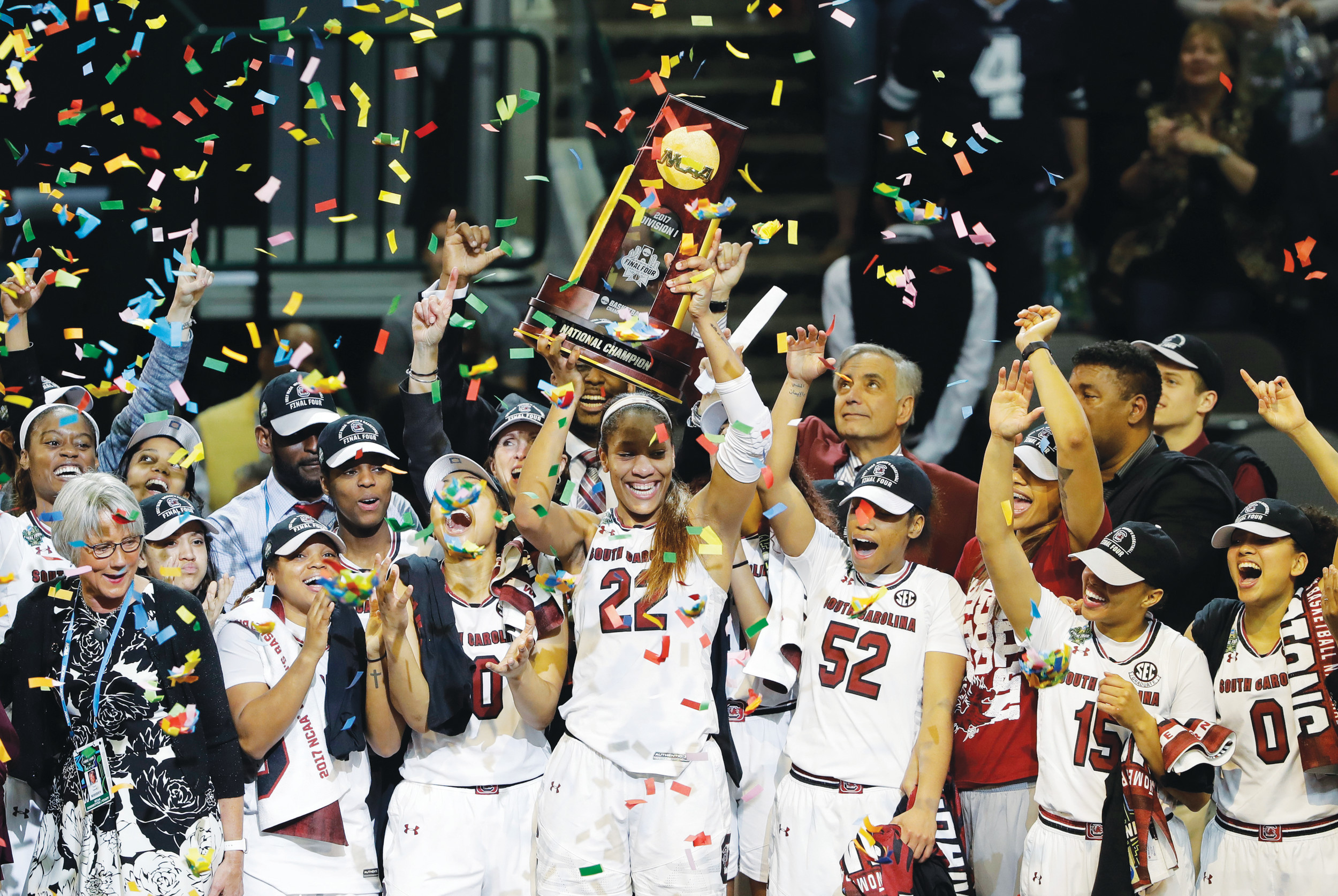 South Carolina forward A'ja Wilson (22) holds up the NCAA women's national championship trophy as she celebrates with teammates after their win over Mississippi State in last year's final in Dallas. Reigning national champion South Carolina leaves behind last year's celebrations and starts preparations this week for a season the Gamecocks hope brings more trophies and cut-down nets their way.