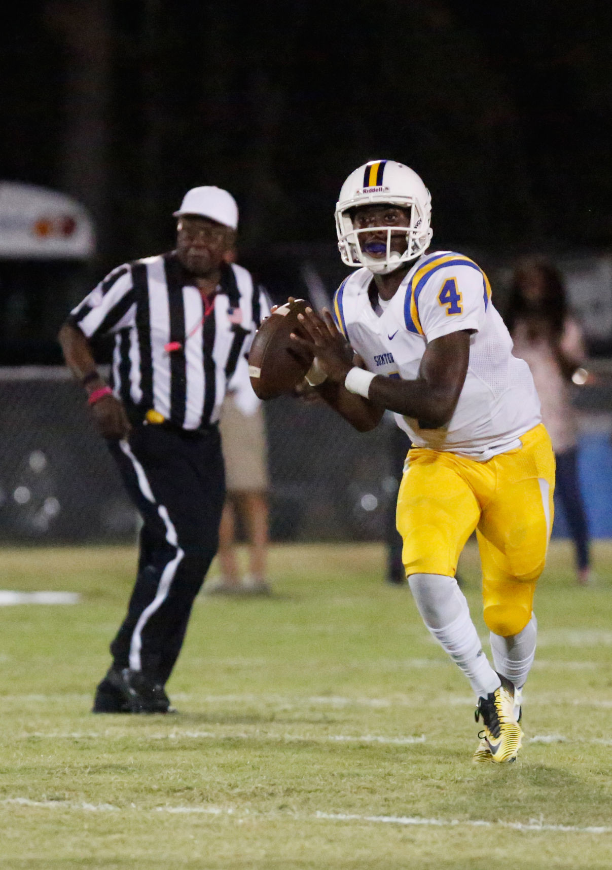 Sumter quarterback Zykiem Jackson (4) looks to thrown down the field in the Gamecocks' 44-6 victory over West Florence on Friday in Florence. Jackson threw for 236 yards and two touchdowns.