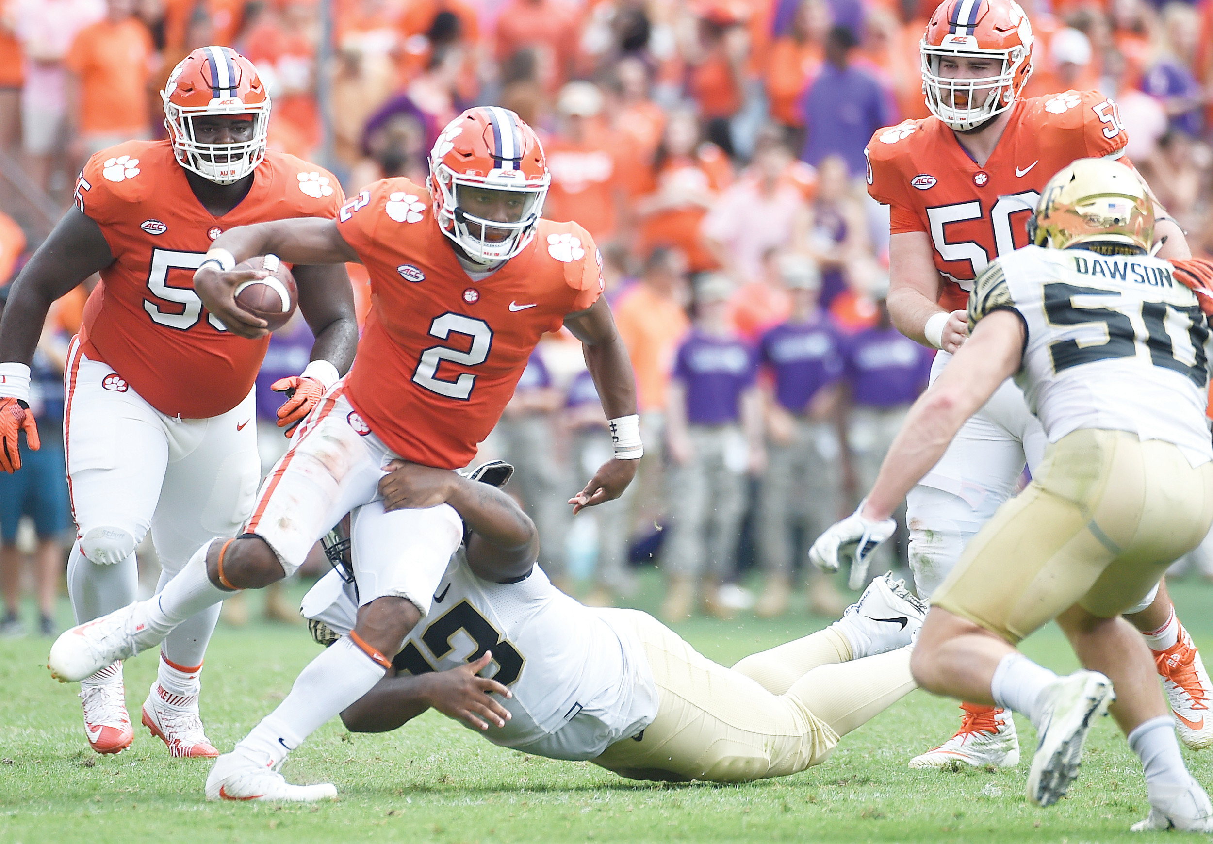 Clemson quarterback Kelly Bryant (2) evades a tackle from Wake Forest defensive lineman Zeek Rodney (93) during the Tigers' 28-14 victory on Saturday at Memorial Stadium in Clemson. Bryant was injured later in the game as his status for Friday's matchup at Syracuse is unknown.