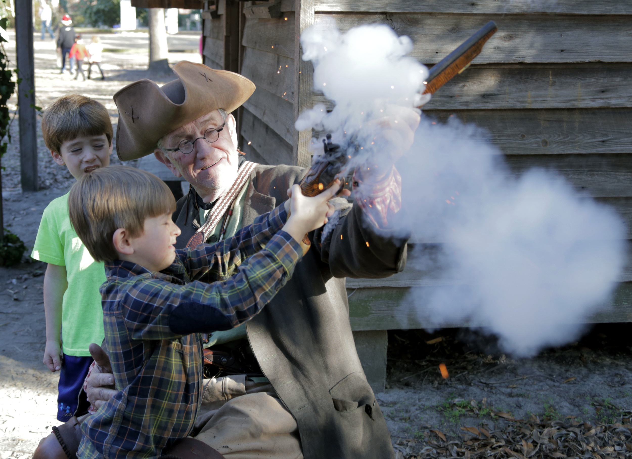 Royce Barham, then 7, fires off a flintlock pistol with the help of Frank Holloway during a Carolina Backcountry event at Sumter County Museum. Holloway will be back in Revolutionary War-era uniform to show and demonstrate his collection of weaponry from that period during Saturday's Carolina Backcountry Harvest event at the museum.