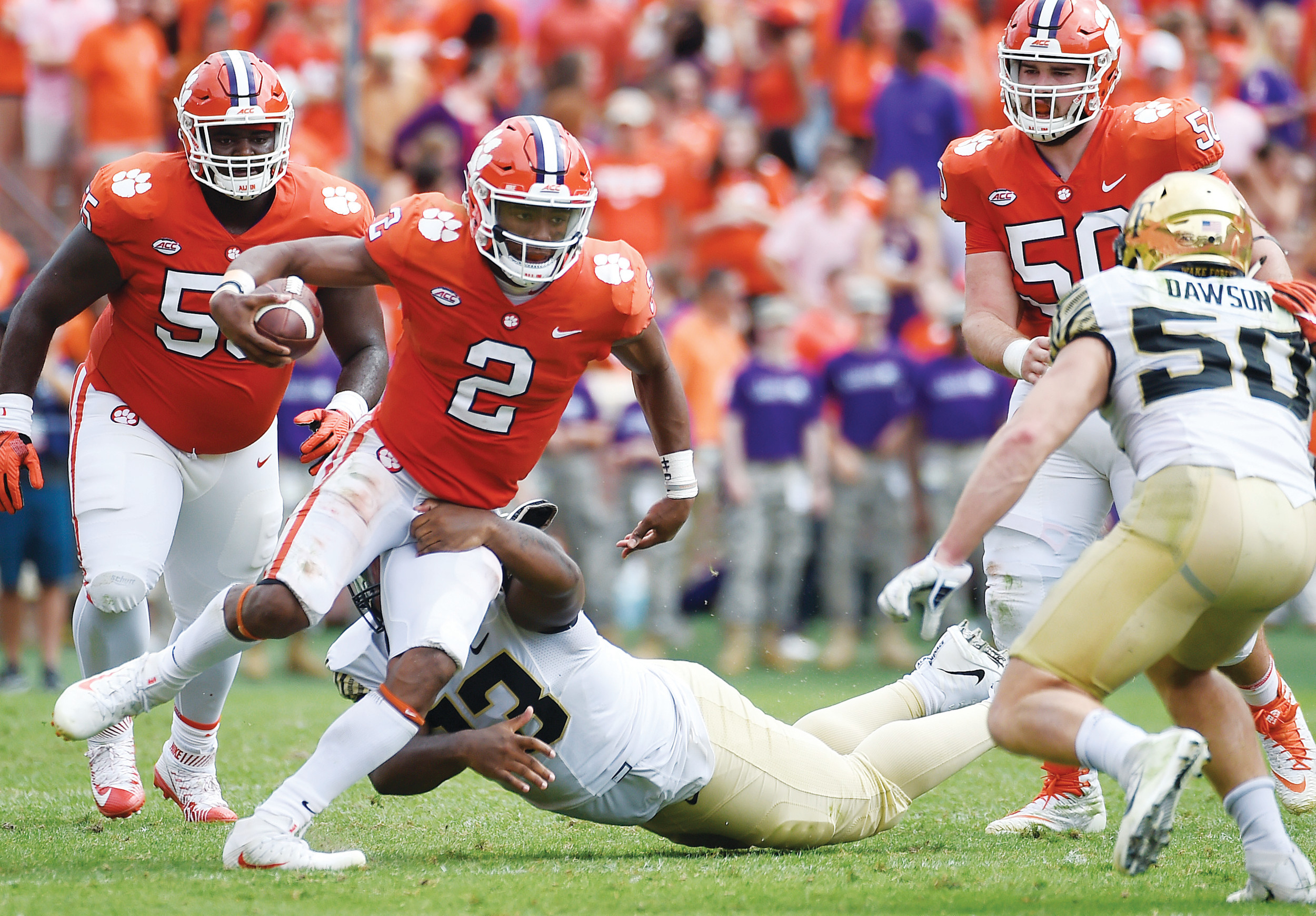Clemson quarterback Kelly Bryant (2) evades Wake Forest defensive end Zeek Rodney (93) during the first half of the Tigers 28-14 victory on Saturday in Clemson. Bryant injured his ankle in the game and is questionable for Friday's game against Syracuse.