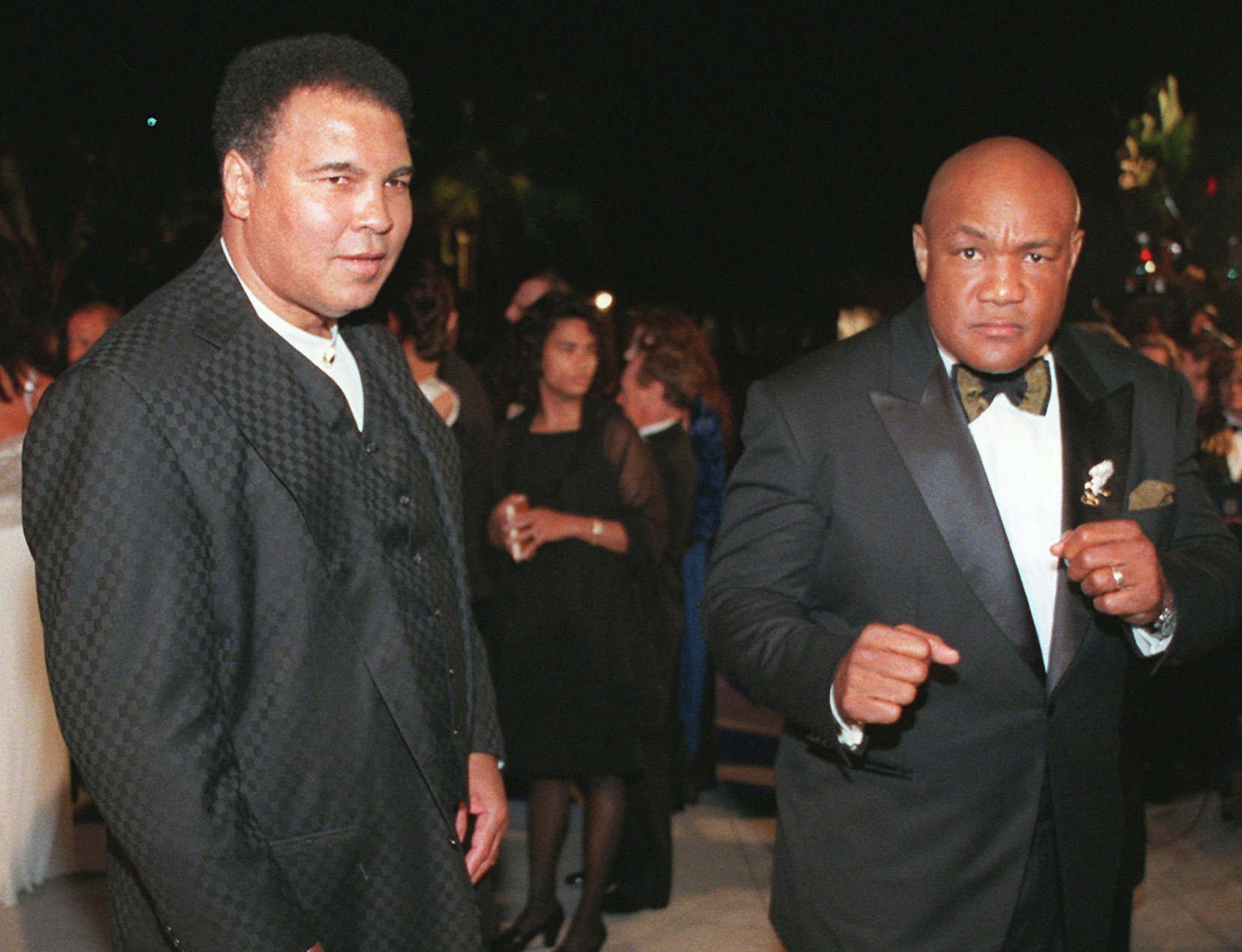 Boxing greats Muhammad Ali, left, and George Foreman arrive at a Vanity Fair Oscar party in West Hollywood, California, in 1997.