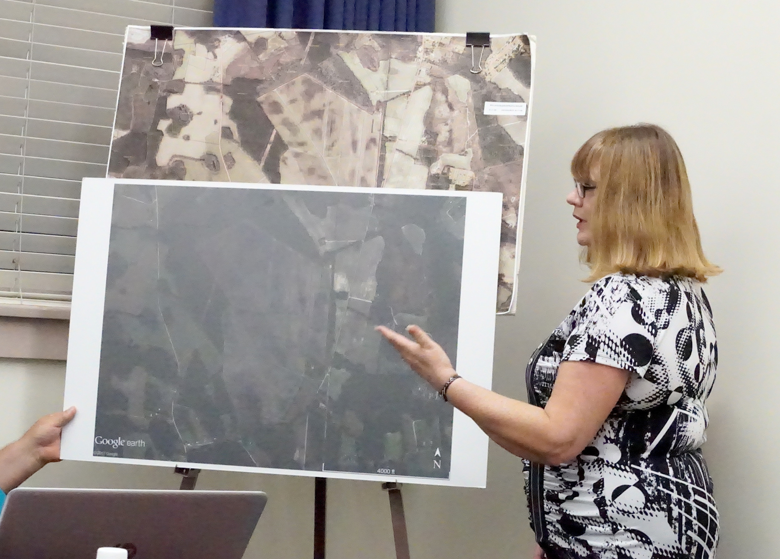 Clarendon County Planning Commission Director Maria Rose shows a map of a proposed solar farm near Paxville at Monday's Clarendon County Council meeting in Summerton. Third reading of an ordinance to change the zoning of a parcel of land in Paxville to allow for a solar farm was approved after the hearing.