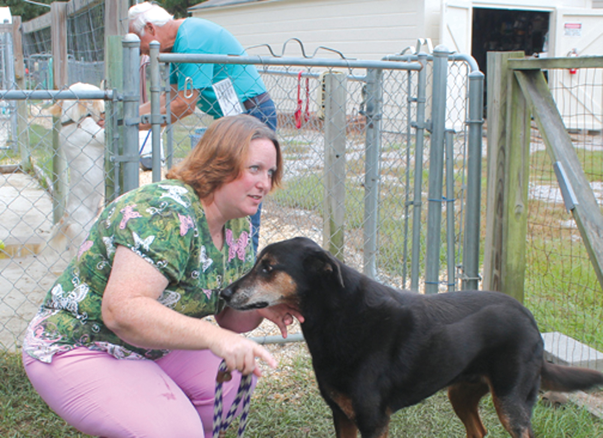 Penny Hodge spends time with Jimmy, the resident at A Second Chance Animal Shelter who has been there the longest.