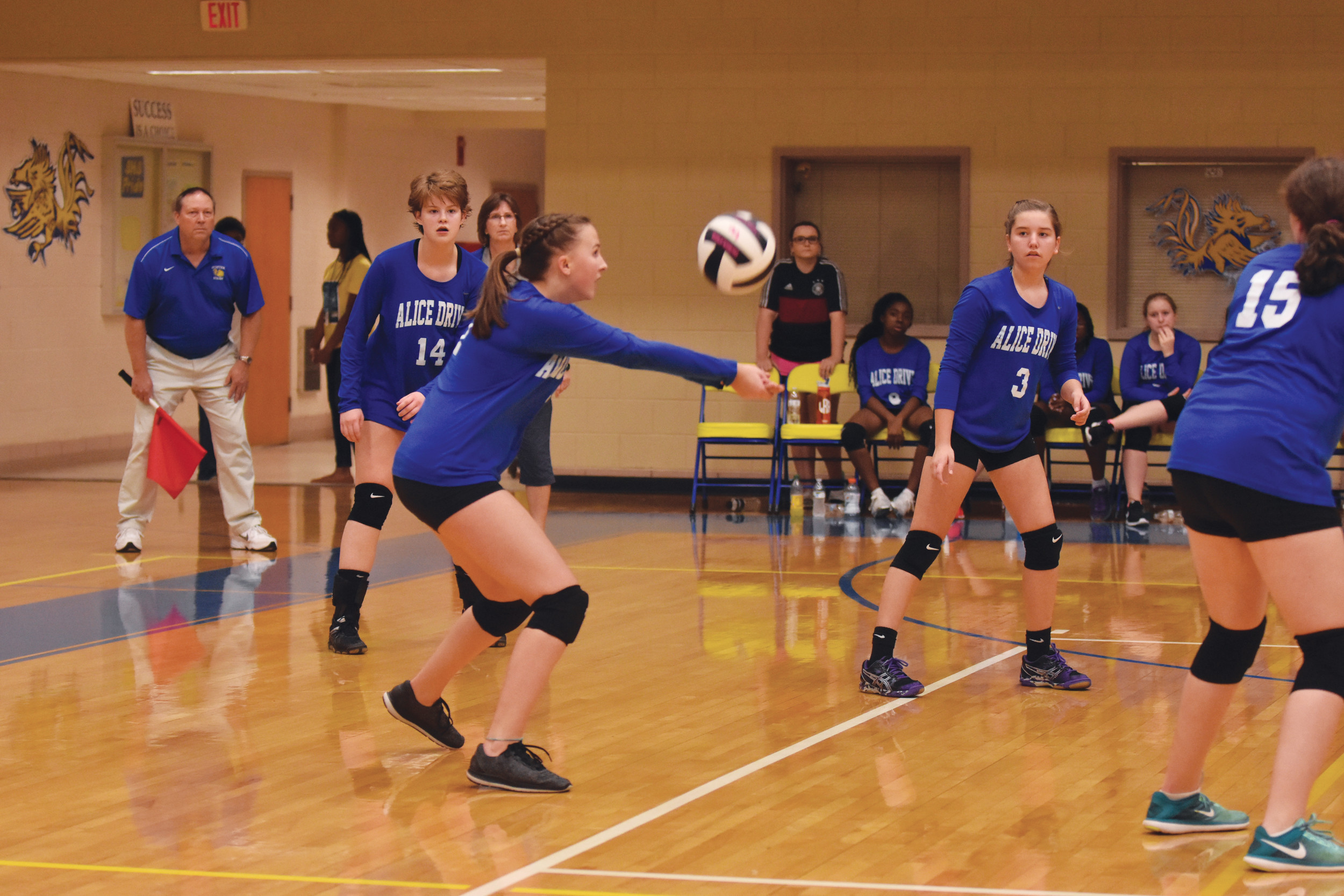 Alice Drive Middle School's Abbegale Bauer sets the ball forward for a teammate during the Hawks' victory over Hillcrest Middle School on Wednesday in the championship match of the Sumter Middle School Conference volleyball tournament at Sumter High School.