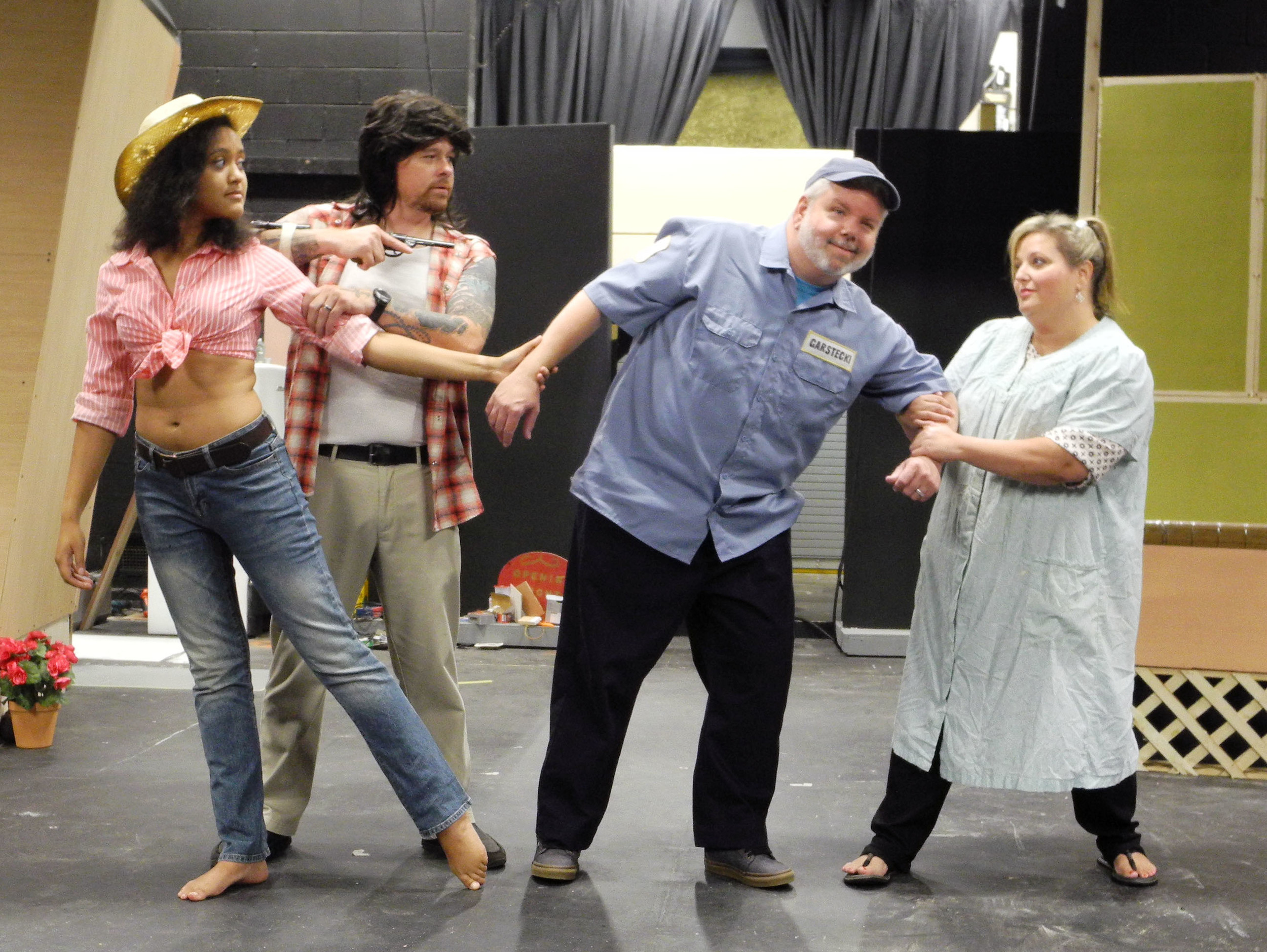 "Norbert, played by John Michael Osteen, is torn between his wife, Jeannie (Alyssa Gibbs), right, and his girlfriend, Pippi (Cierra Stewart), far left, as Pippi's ""Magic Marker-sniffing"" ex-boyfriend, Duke (Morgan Wood), attempts to get her back. The four actors are in rehearsal for the musical comedy ""The Great American Trailer Park Musical,"" directed by Traci Quinn. The show opens Thursday at Sumter Little Theatre."