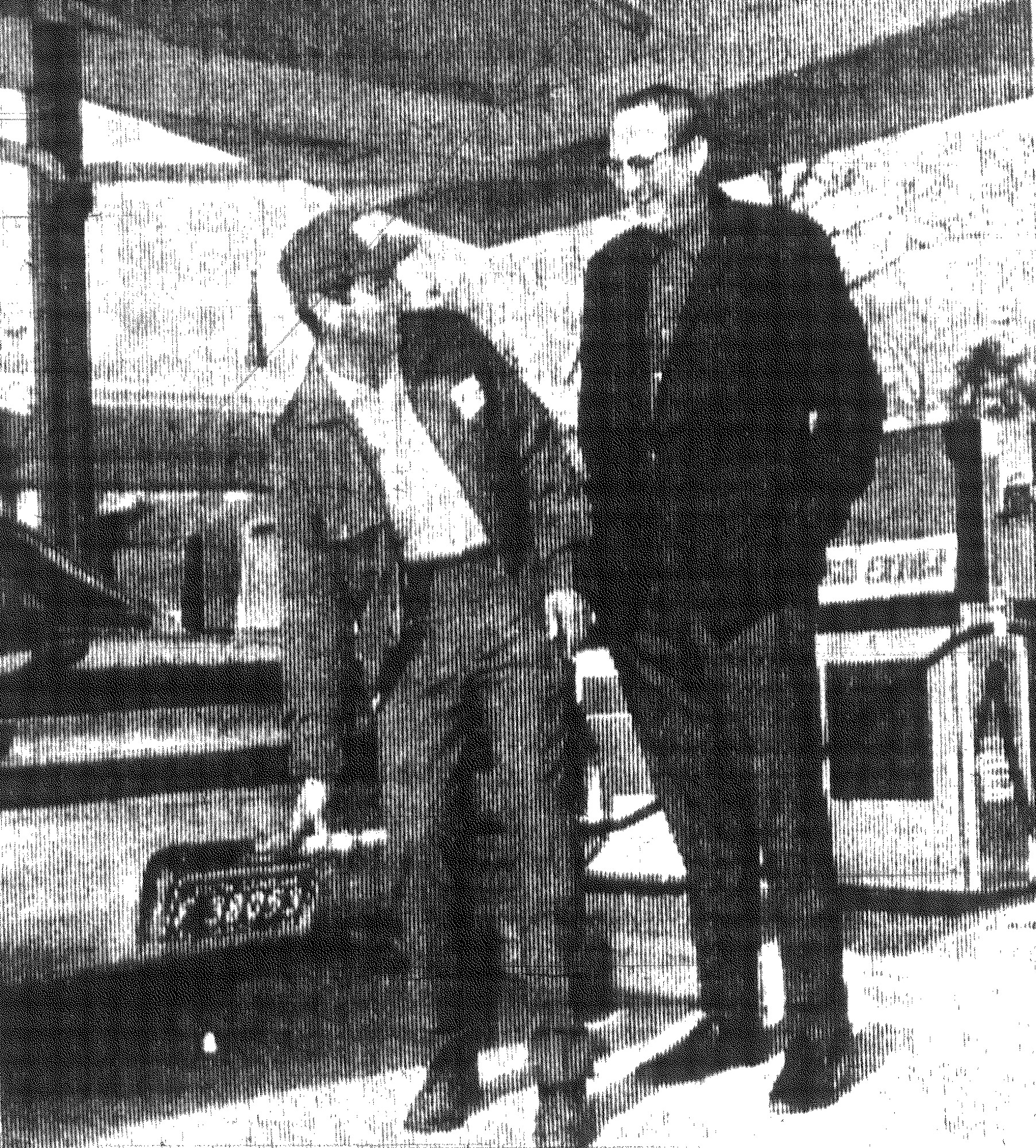 1968 - Bill Cockerill serves Frank Hirt, his first customer, as a new Bill's Esso Station opened at the corner of Main and Calhoun streets.
