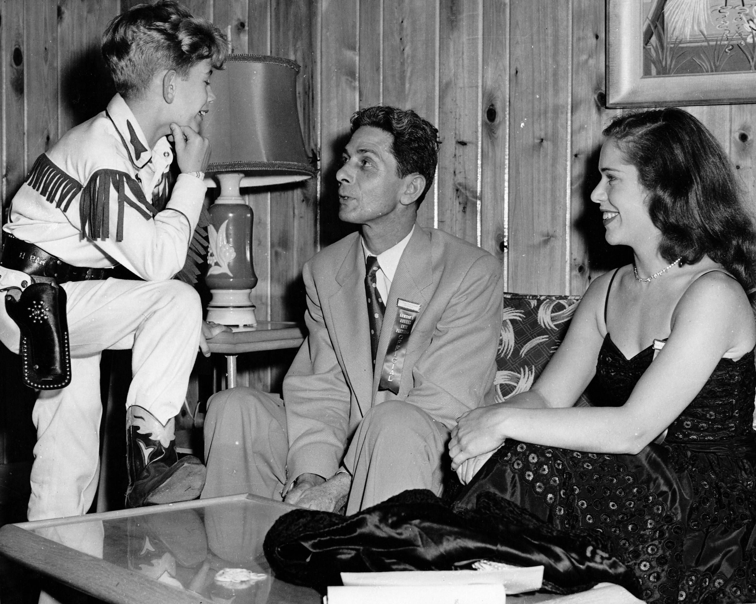 Child star Bobby Benson talks with T. Doug Youngblood and one of the visiting Iris beauties in 1952.