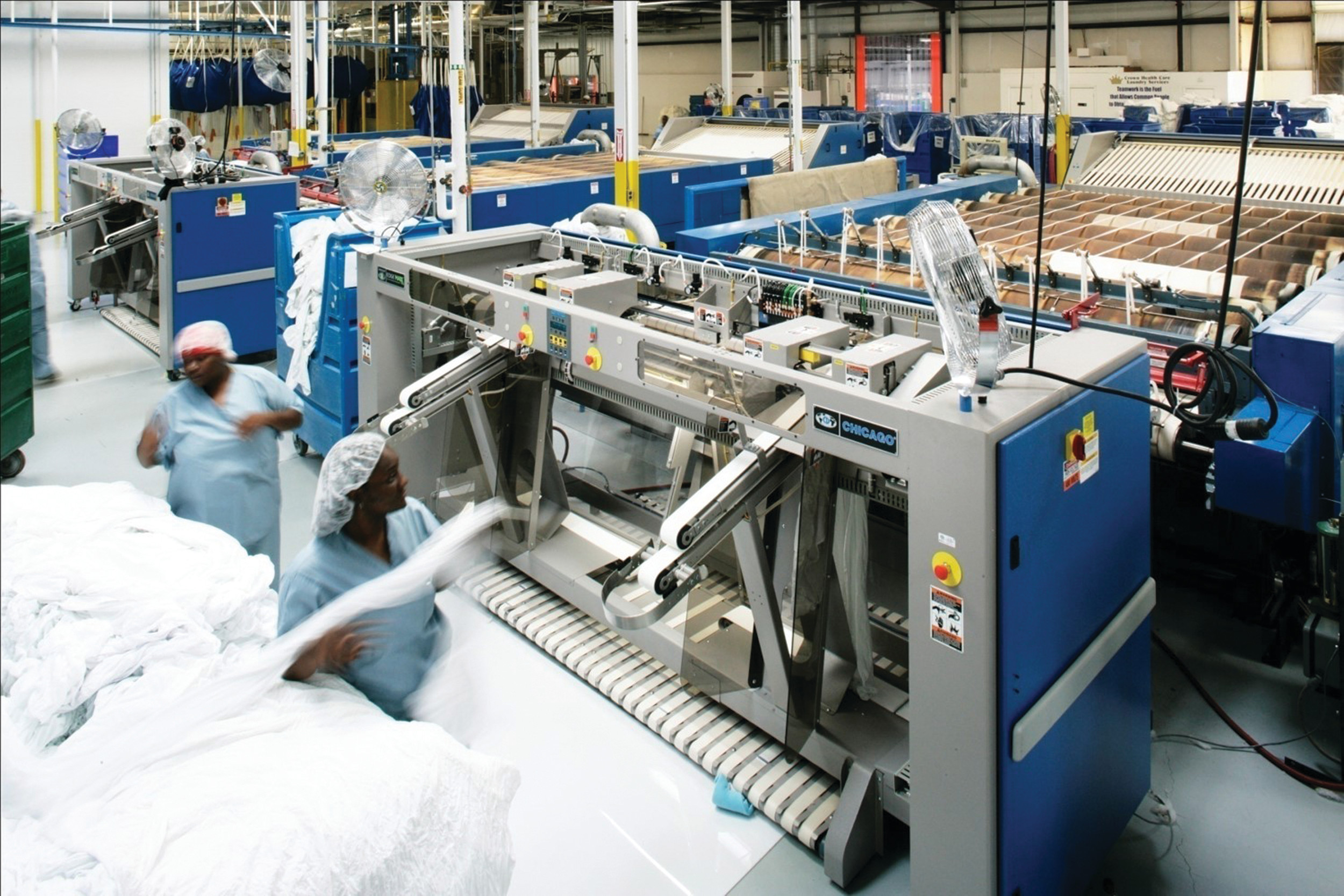Production operators sort linens recently at a Crown Health Care Laundry Services processing facility in Quitman, Georgia. The company's Bishopville plant is set to open Nov. 1, according to a company official.