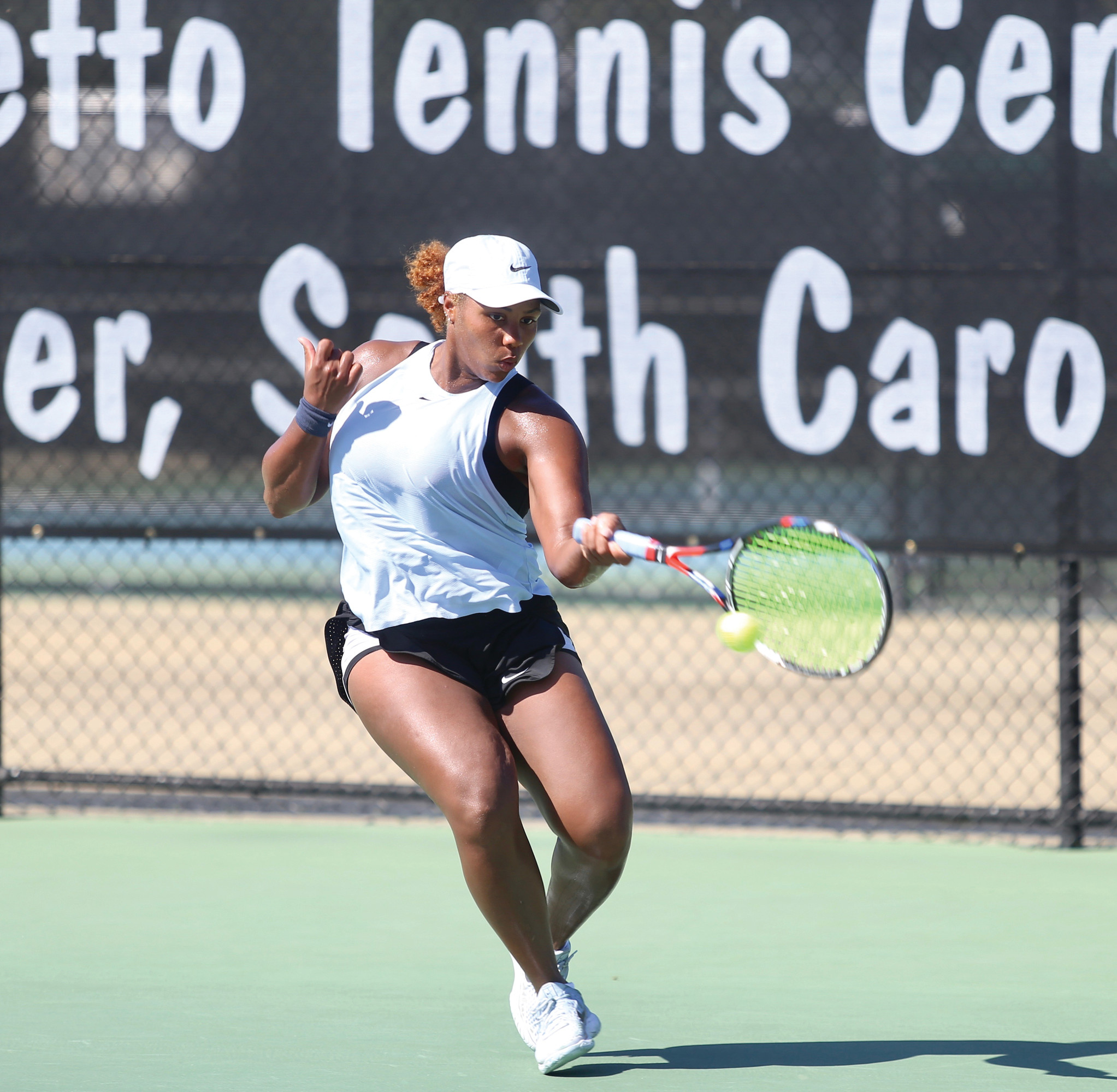 TREVOR BAUKNIGHT /   THE SUMTER ITEMTaylor Townsend returns a  shot during her 6-2,  6-1 victory over  Ulrikke Eikeri in the  singles championship  match of the Sumter  Pink Open on Sunday  at Palmetto Tennis  Center. Townsend  was also a part of the  winning doubles  team.