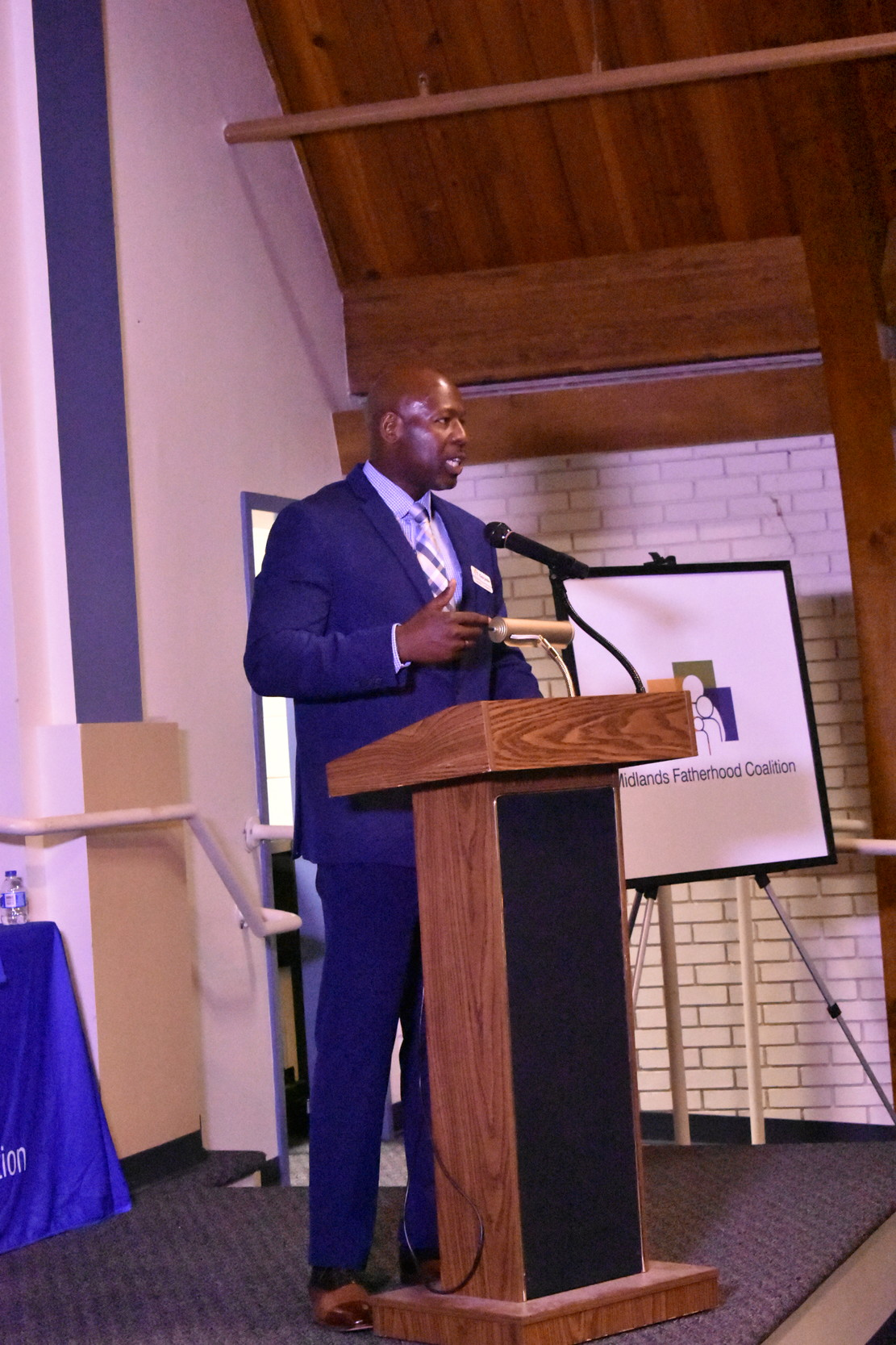 Keito Jordan, outreach coordinator for the Richland County site of the Midlands Fatherhood Coalition, speaks Thursday at the group's first graduation in Sumter.