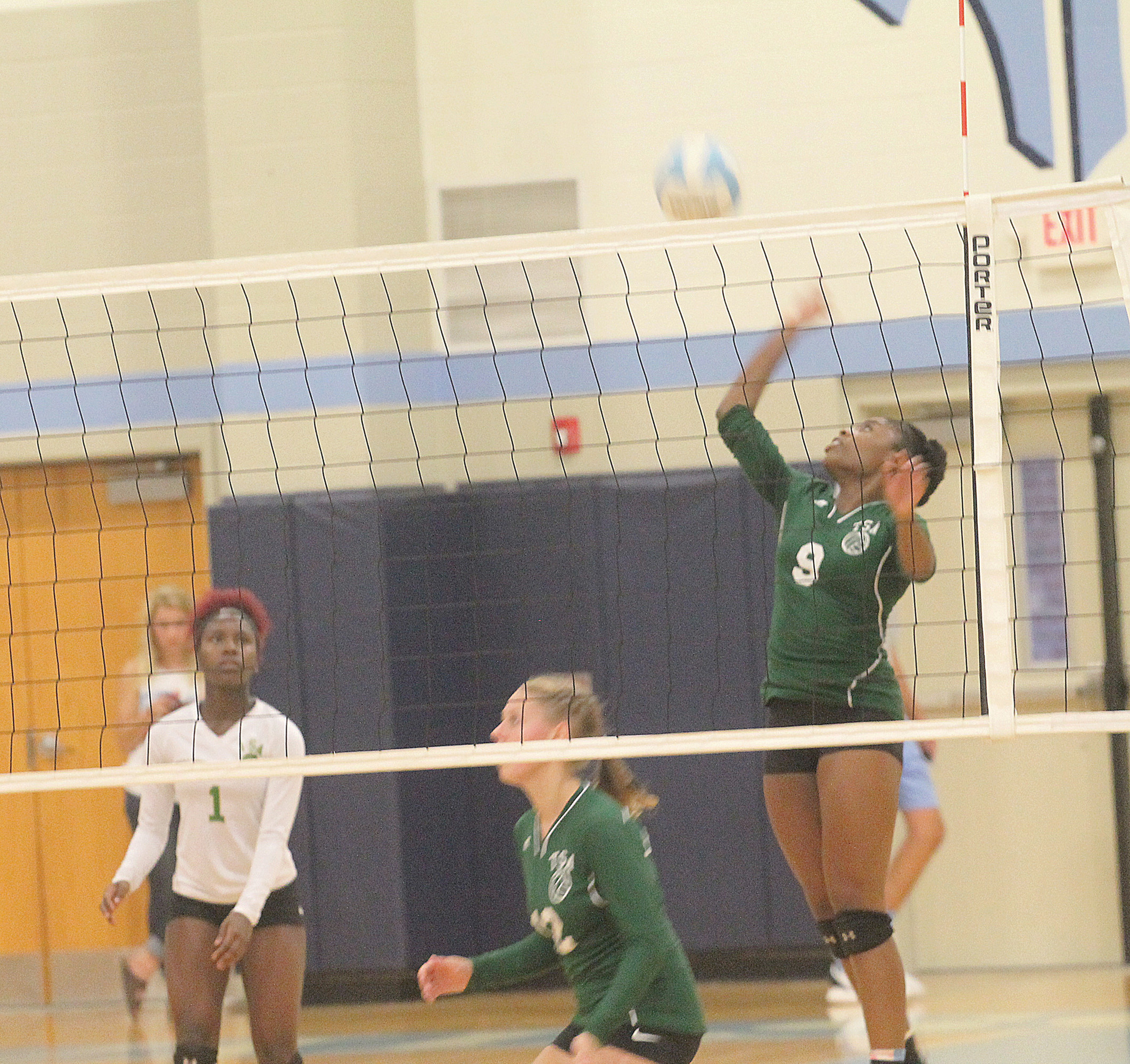Thomas Sumter's Anita Cookey-Gam (9) goes up for a kill during the Lady Generals' match at Wilson