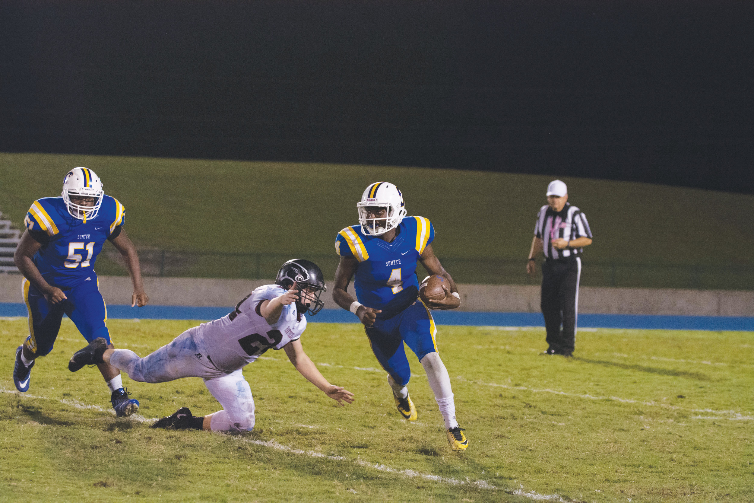 Sumter High quarterback Zykiem Jackson looks for running room during last week's homecoming victory over Carolina Forest. Sumter faces Conway today at 7:30 p.m. at Memorial Stadium with the Region VI-5A title on the line.