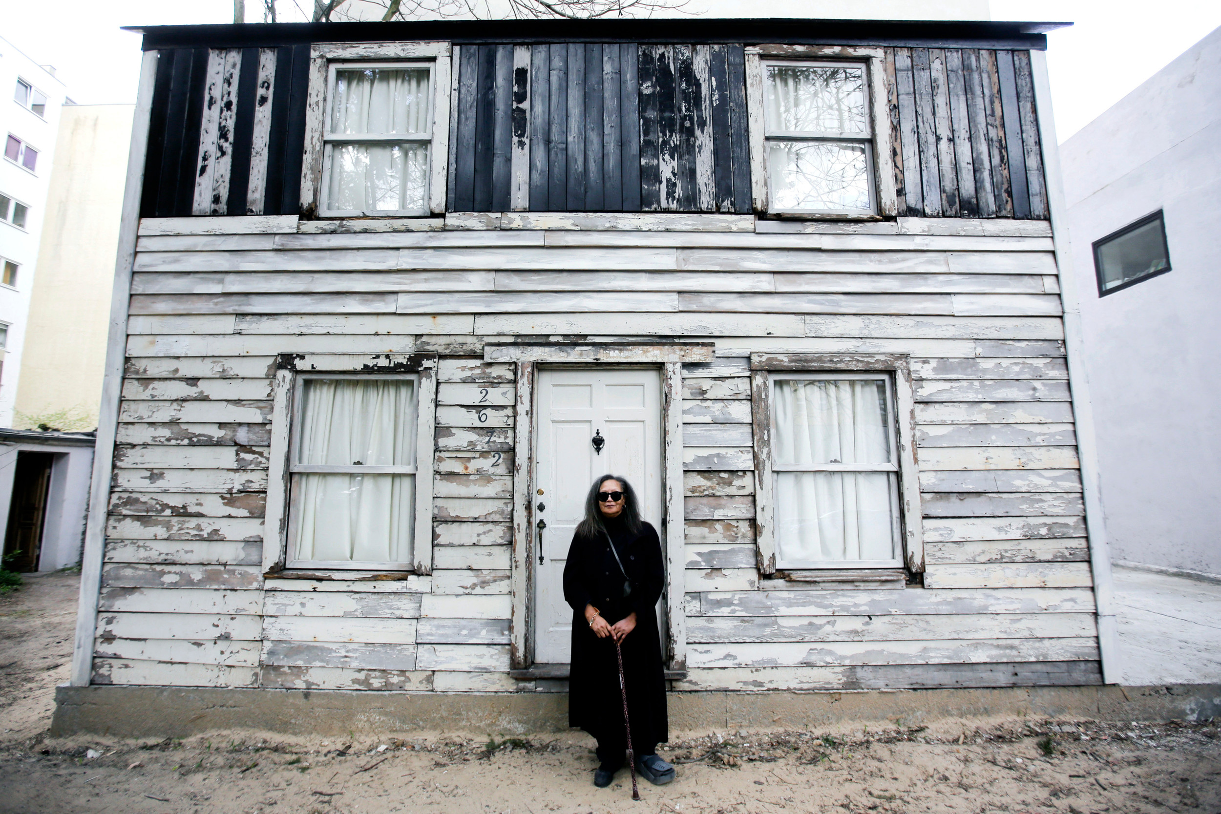 Rhea McCauley, a niece of Rosa Parks, is seen in front of the rebuilt house of the late civil rights activist on April 6 in Berlin. McCauley donated the house, originally located in Detroit, to American artist Ryan Mendoza, who dismantled and and rebuilt it in the German capital. Brown University said in October it is looking to temporarily relocate the house from Berlin to Providence, Rhode Island.