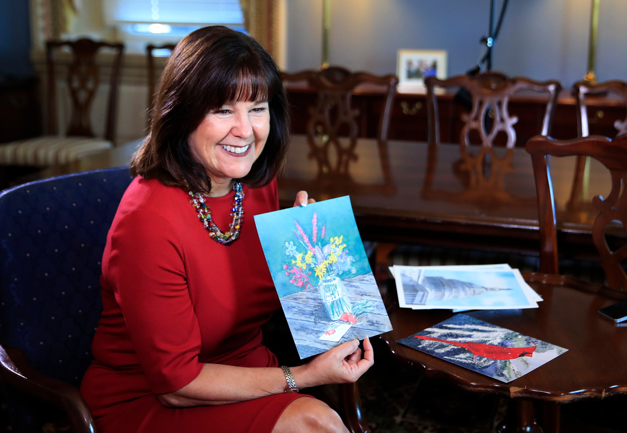 Karen Pence, wife of Vice President Mike Pence, shows her artwork during an interview Tuesday in her office at the Eisenhower Executive Office Building at the White House complex in Washington, D.C. Pence is using her platform as the vice president's wife to raise awareness about art therapy, a mental health field she's been passionate about for a decade.