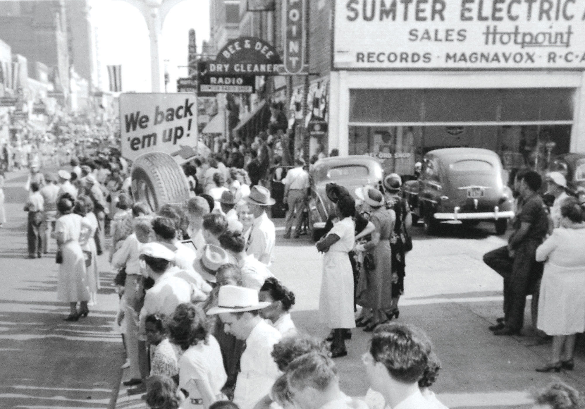 Paradegoers line Main Street outside of Sumter Electric and Appliance Co., which was eventually shortened to SEACO.