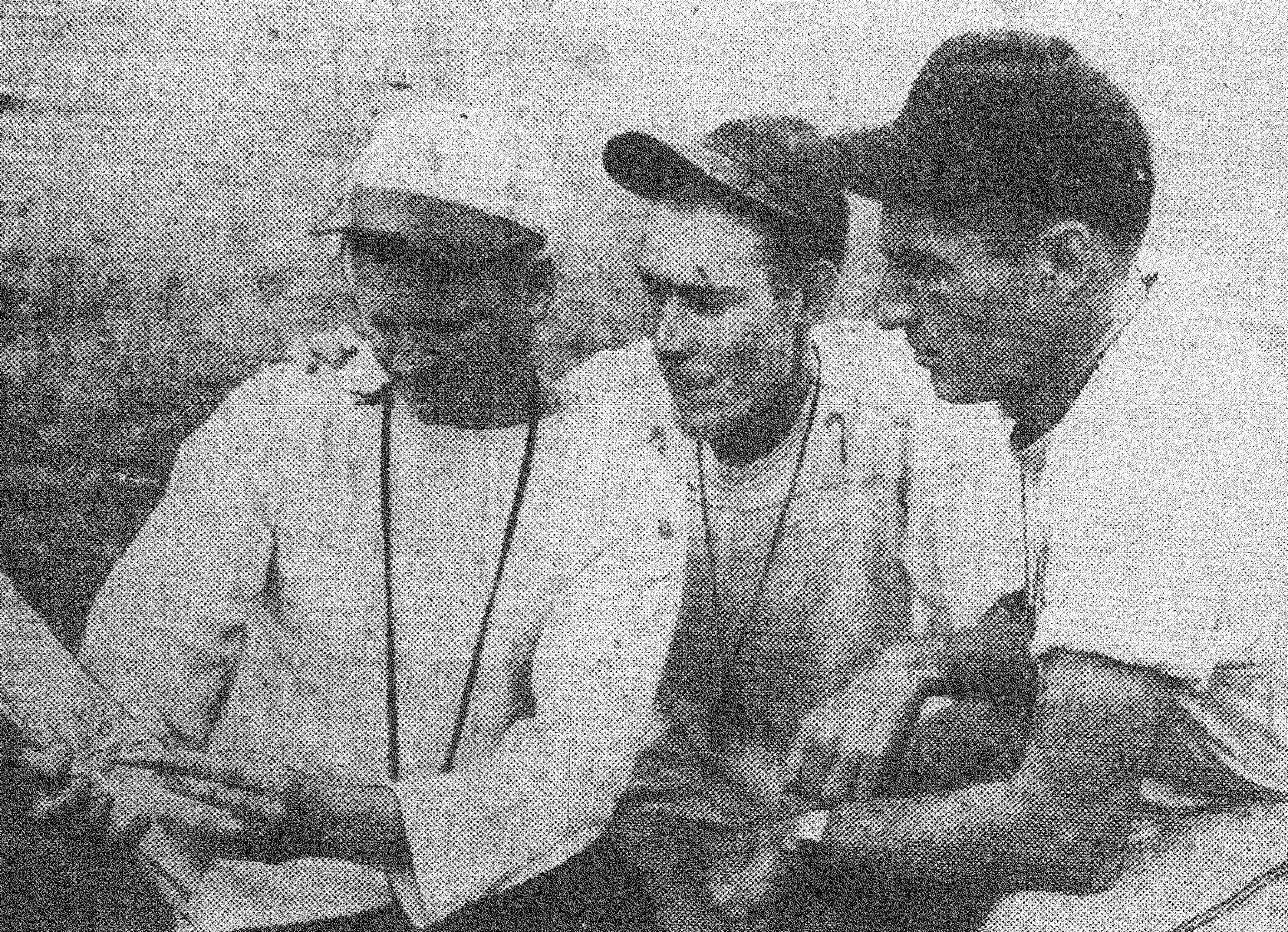 Football plays are planned by, from left, Hutch Hutchinson, head coach, and assistants Earle J. Moore and Barney S. Haynes.