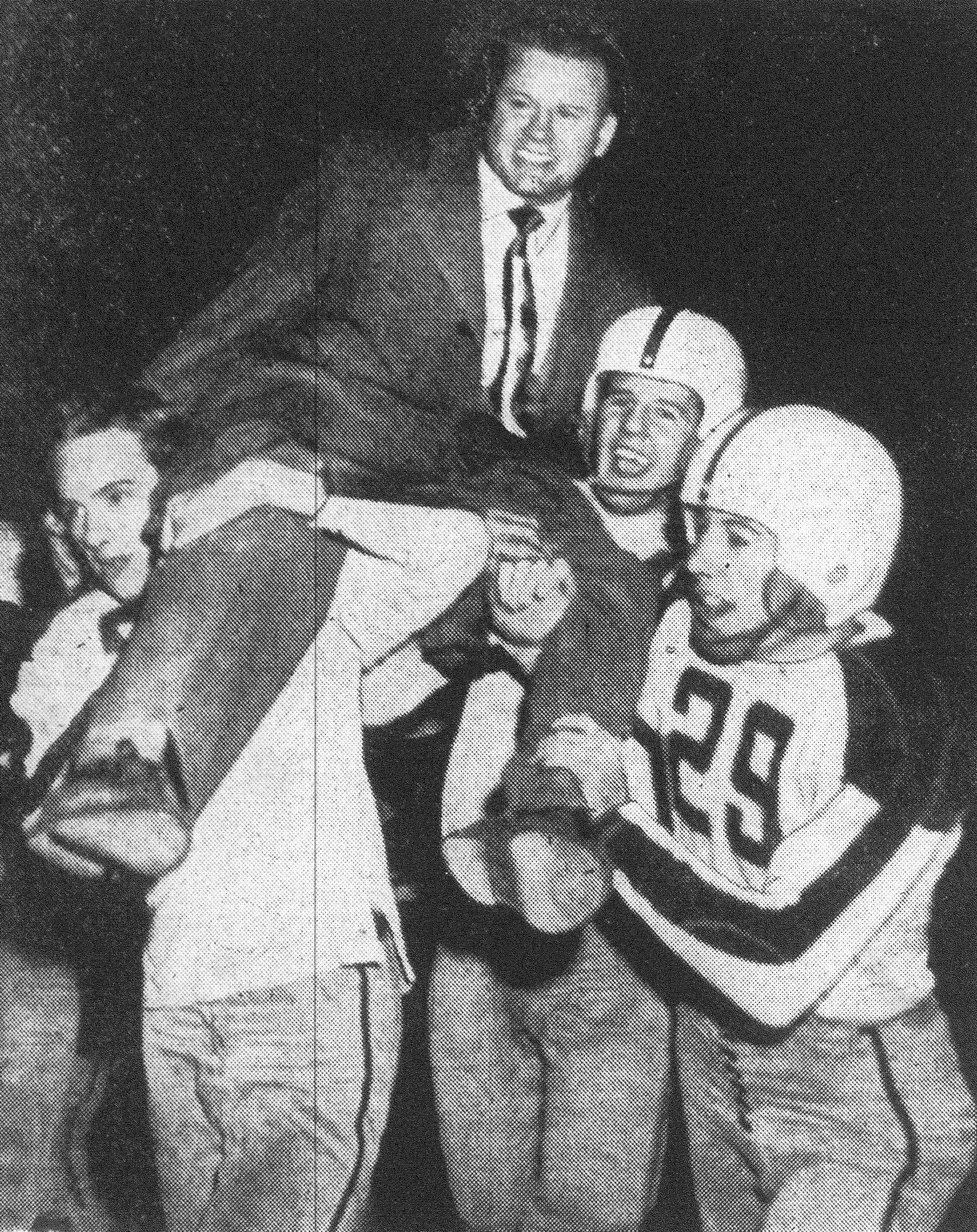 From left, Sugar Cain, Robert Brunson and Russell Sutton hoist Hutch Hutchinson to their shoulders and carry him off the field in celebration of the Gamecocks 21-0 victory over Florence and the completion of a successful football season.