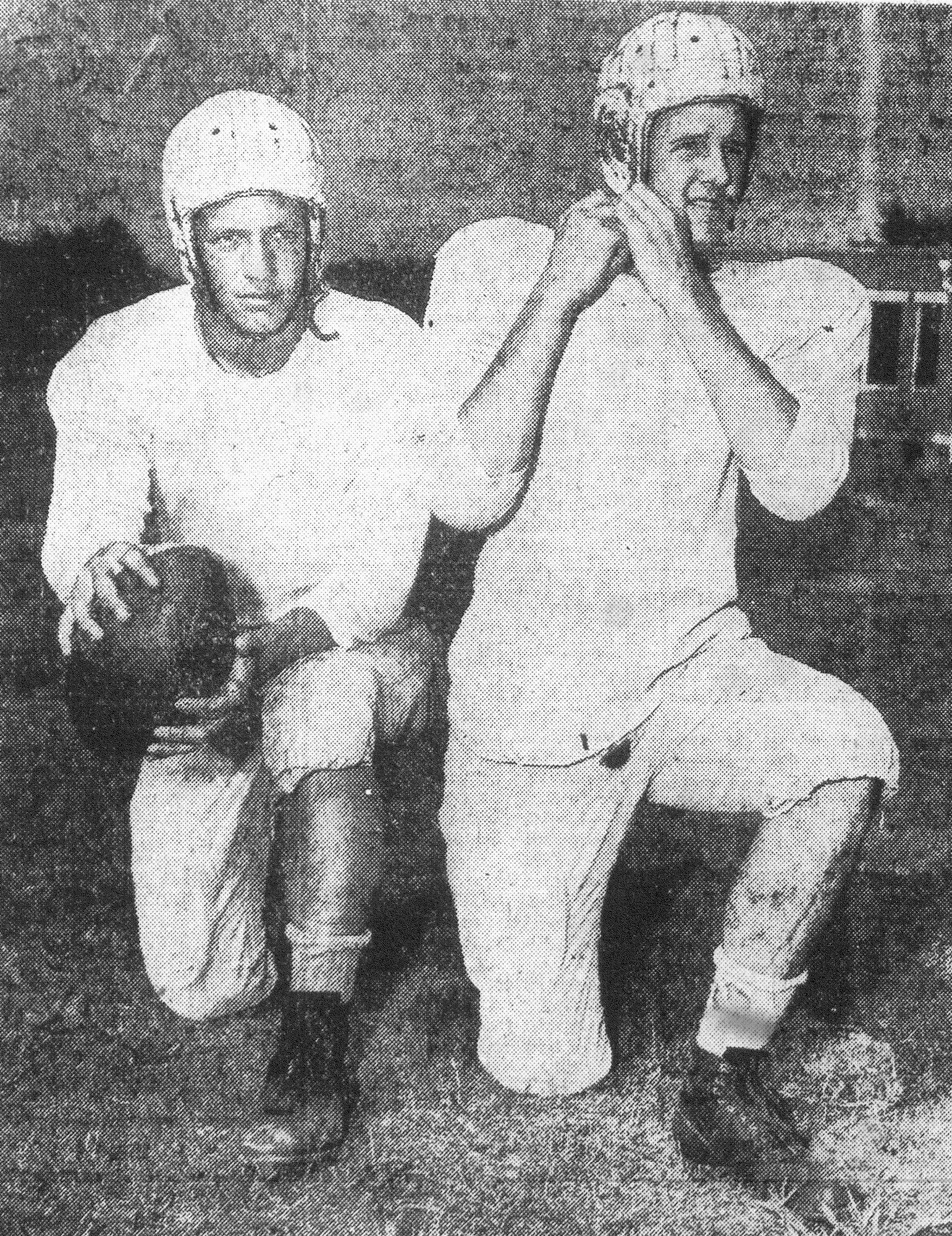 "Sumter High's football team recently elected Francis ""Sugar"" Cain, quarterback, at left, and Robert Brunson, center, as co-captains for the coming season."