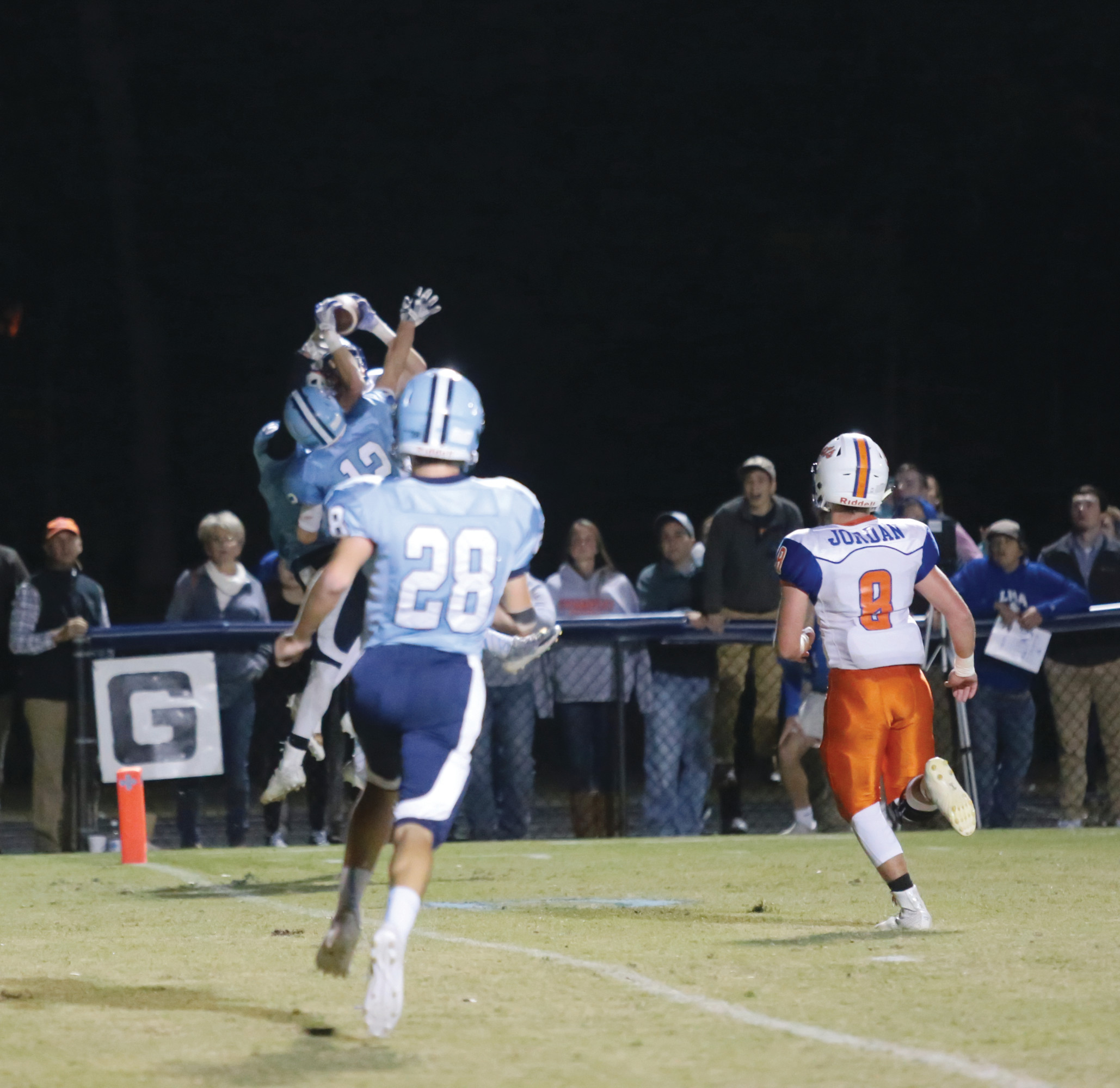 Laurence Manning wide receiver Taylor Lee makes the game-winning touchdown catch in a forest of Wilson Hall defenders. The point-after kick gave the Swampcats a 14-13 victory on Friday at Spencer Field.