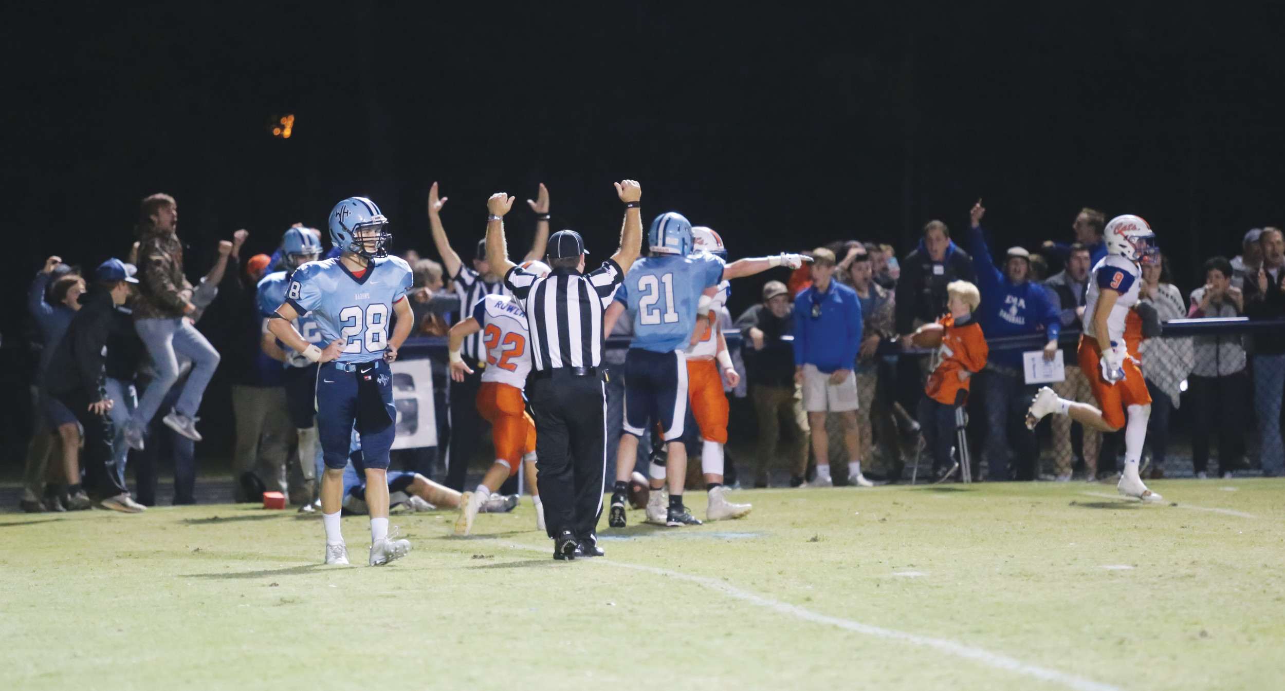 Laurence Manning faithful celebrate with the team along the sidelines after Taylor Lee's game-winning touchdown reception that gave the Swampcats a 14-13 victory over Wilson Hall on Friday at Spencer Field.