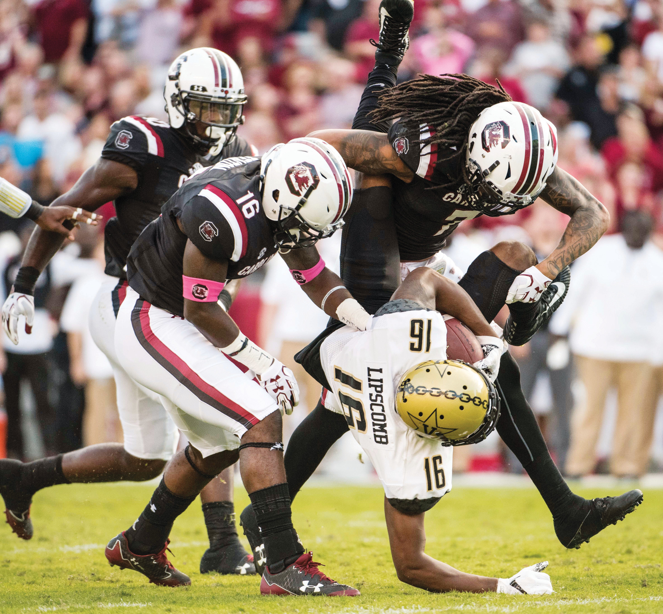 THE ASSOCIATED PRESS  South Carolina defensive backs JaMarcus King (7) and Rashad Fenton (16) tackle Vanderbilt wide receiver Kalija Lipscomb (16) during the Gamecocks' 34-27 victory on Saturday in Columbia