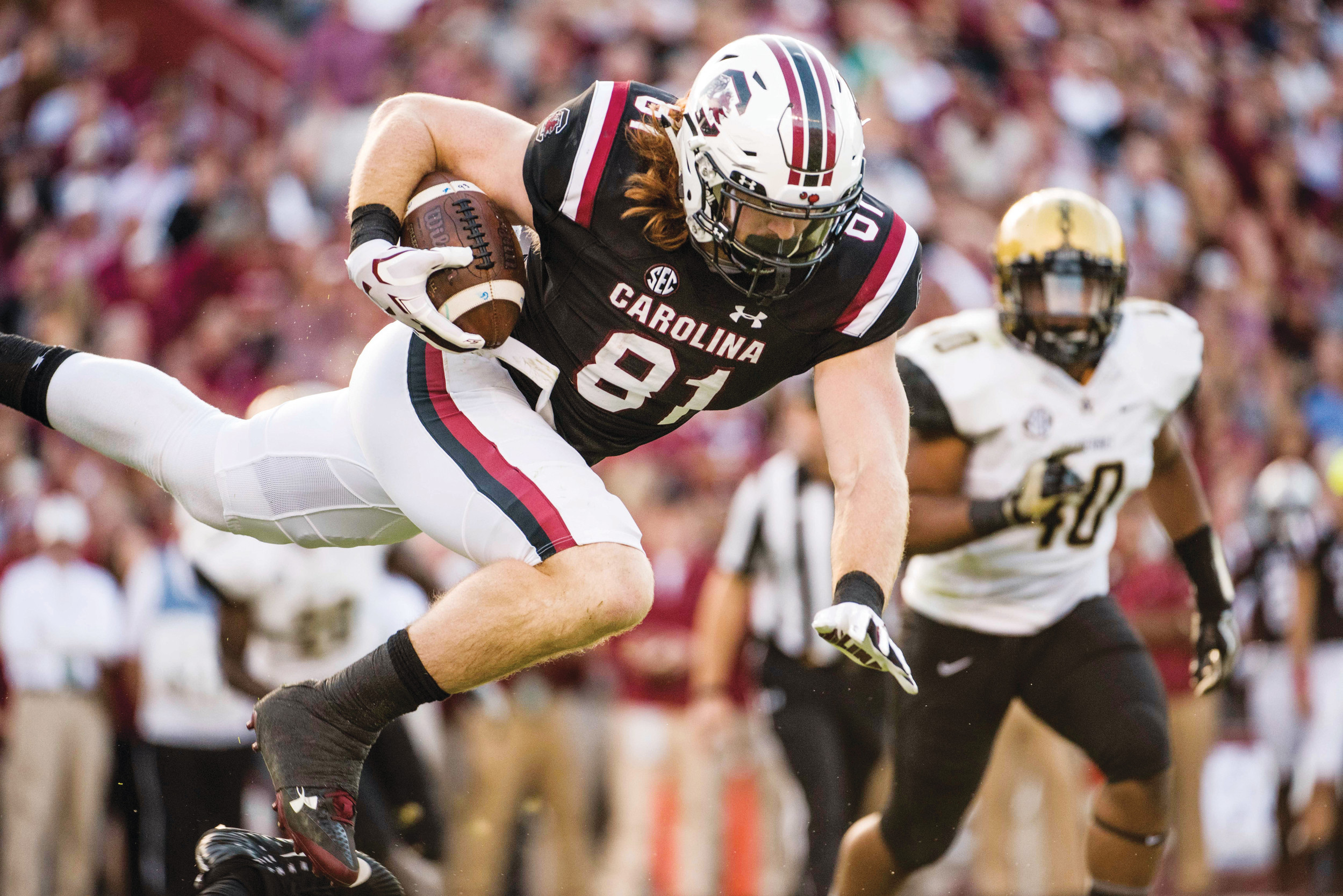 THE ASSOCIATED PRESS  South Carolina tight end Hayden Hurst (81) is upended by the Vanderbilt defense during the first half of an NCAA college football game Saturday, Oct. 28, 2017, in Columbia, S.C. (AP Photo/Sean Rayford)