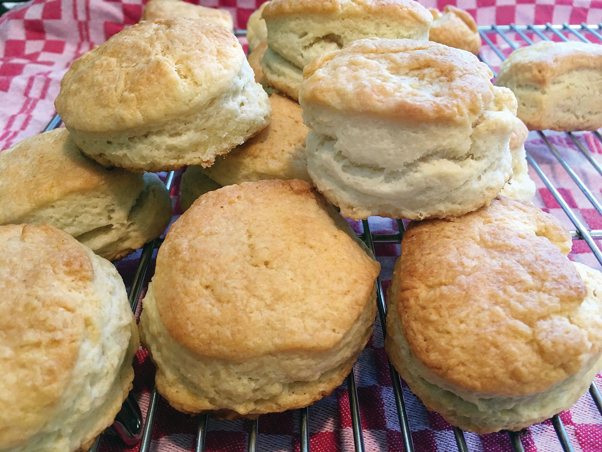 This Oct. 13, 2017 photo shows Elizabeth Karmel's simple three-ingredient recipe buttermilk biscuits. The biscuits use self-rising flour, lard and real buttermilk. Once the biscuits are cut, and on the cookie sheet, the tops are brushed with melted butter before and after baking. (AP Photo/Elizabeth Karmel)