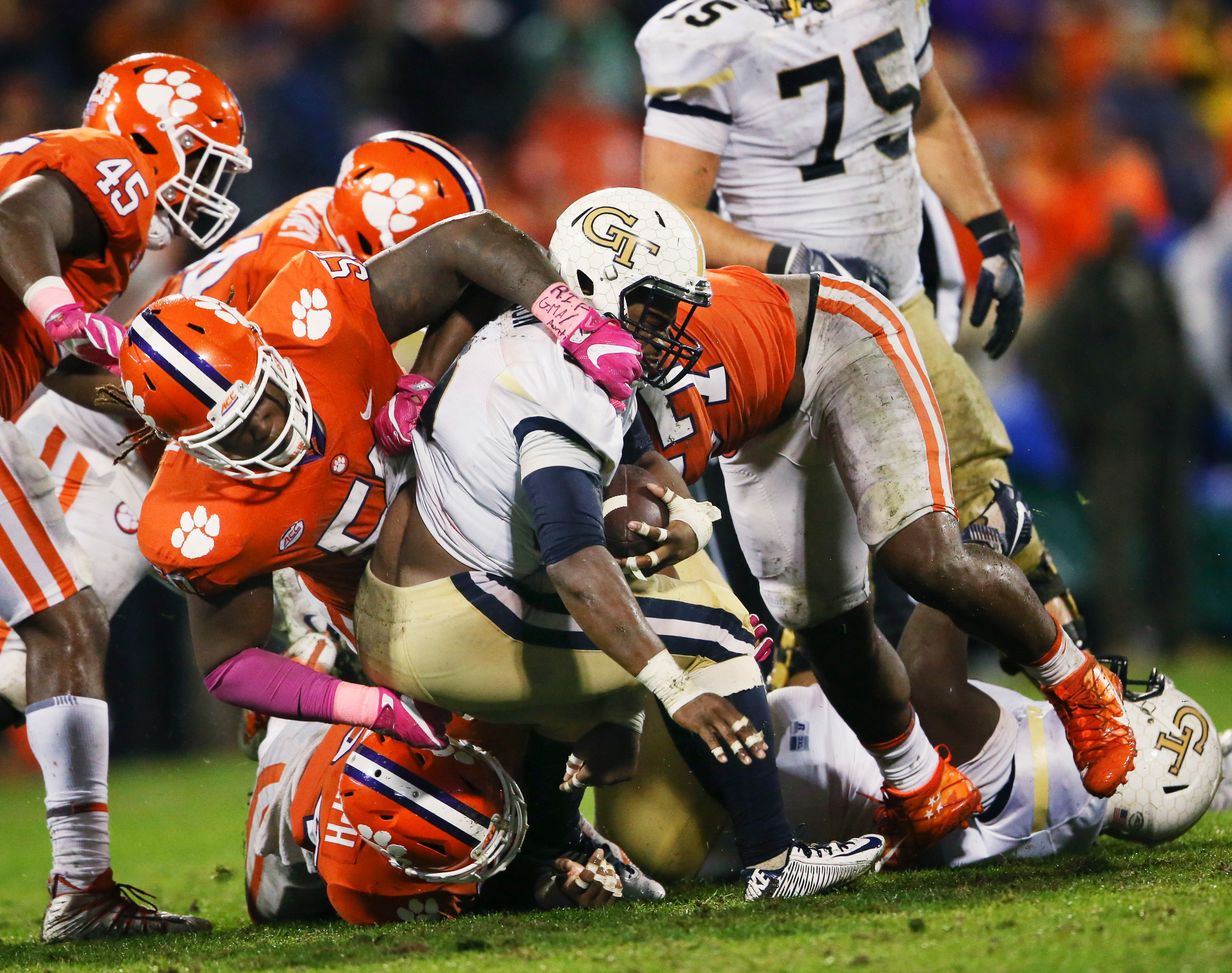 The Associated Press  Georgia Tech running back KirVonte Benson (30) is stopped by a host of Clemson Tigers in Clemson's 24-10 victory on Saturday in Clemson. The Tigers will be taking on N.C. State on Saturday with a the ACC Atlantic Division title on the line.