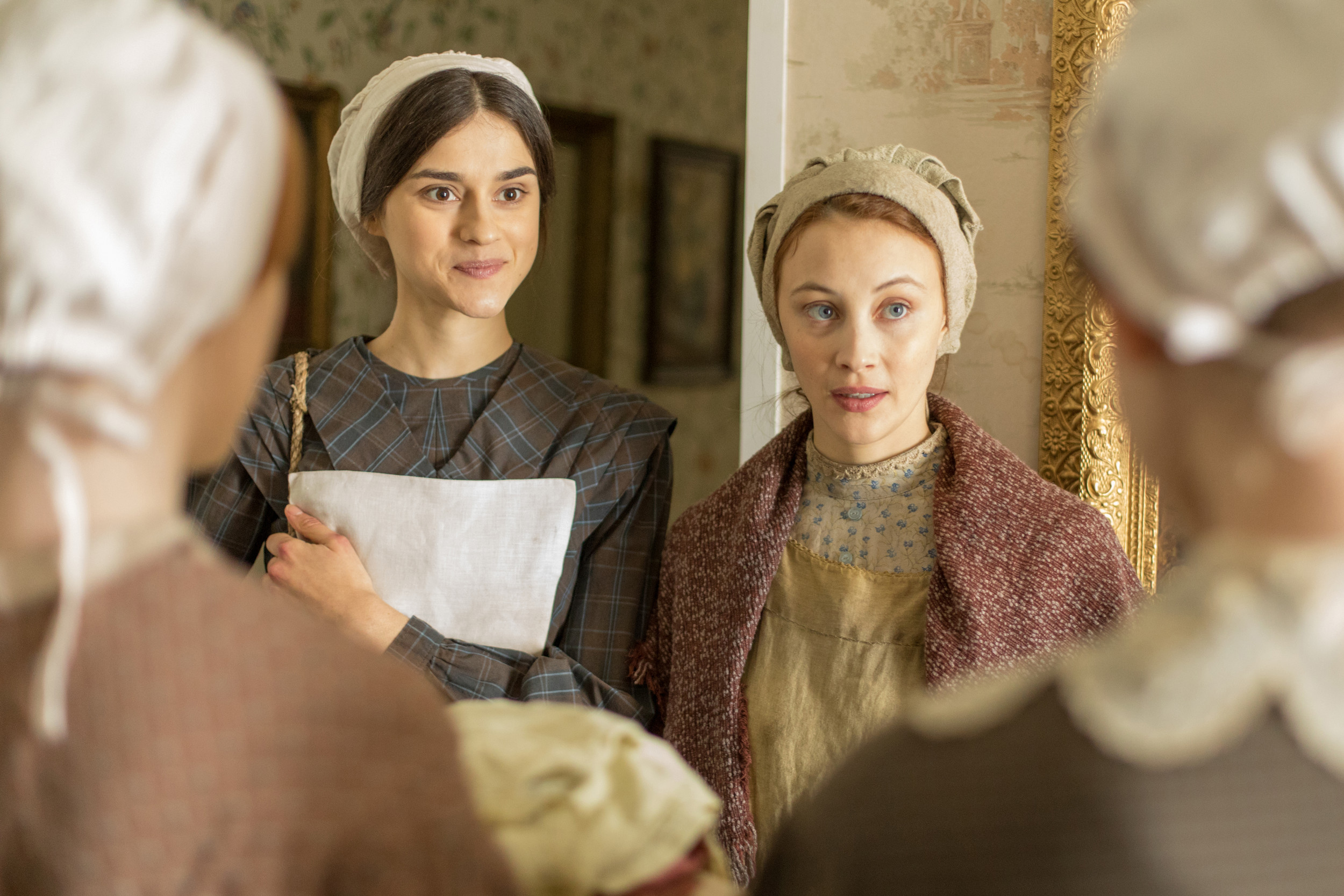 "Rebecca Liddiard, left, stars as Mary Whitney and Sarah Gadon as Grace Marks in ""Alias Grace,"" now streaming on Netflix."