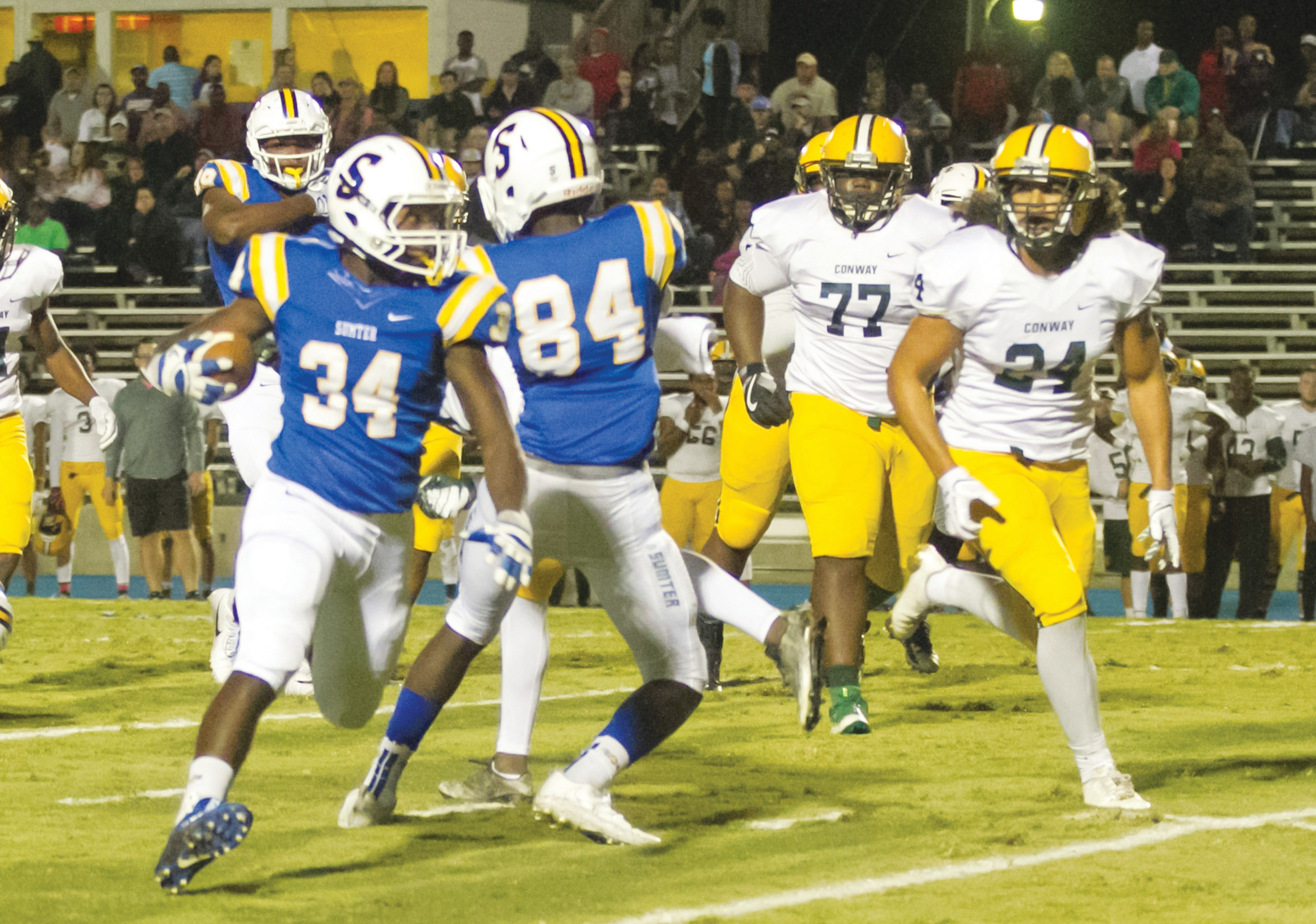 Sumter running back Da'jon Butts (34) turns the corner in the Gamecocks' 14-13 loss to Conway on Oct. 20. SHS will be playing host to White Knoll in the first round of the 5A state playoffs today at Memorial Stadium beginning at 7:30 p.m.