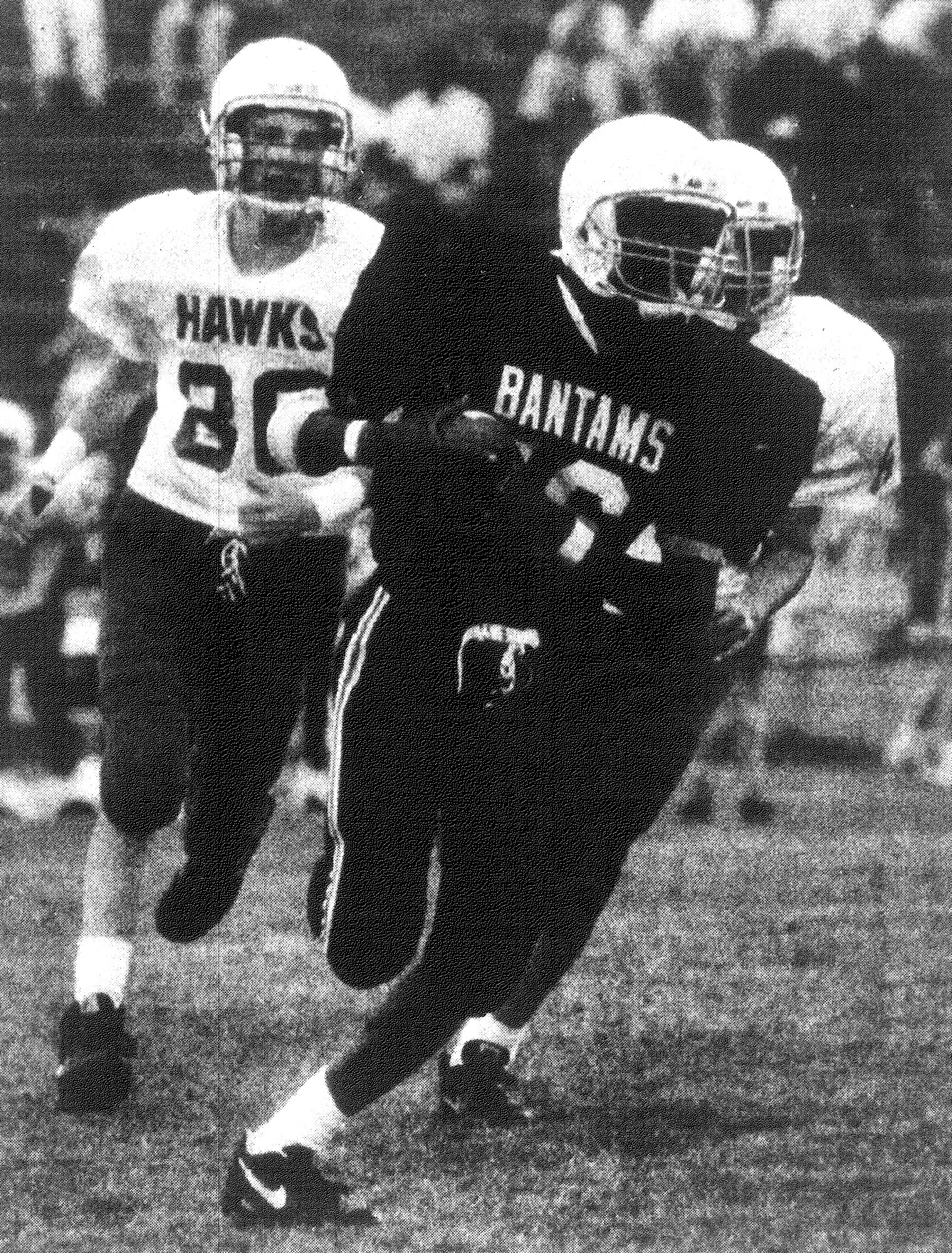 SUMTER ITEM FILE PHOTO  1992 - Bates Middle School's quarterback Fred White runs away from a pair of Alice Drive defenders during the Bantams' 44-22 win at Memorial Stadium. It was the last game of the season for both teams.