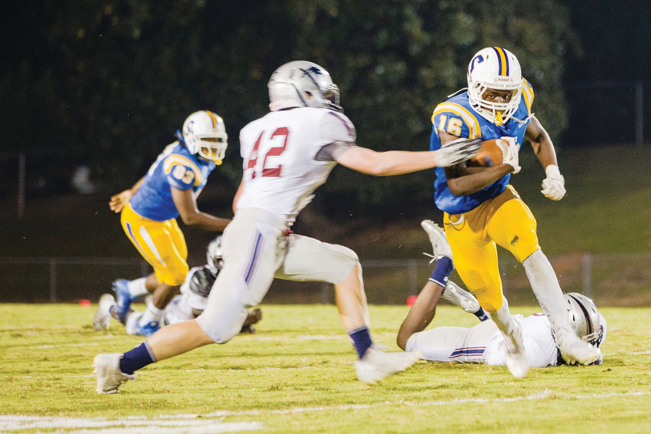 Sumter running back Jonathan Henry (16) runs the ball during the Gamecocks' 35-7 victory over White Knoll in the opening round of the 5A state playoffs on Friday at Memorial Stadium. Henry rushed for 203 yards and two touchdowns.
