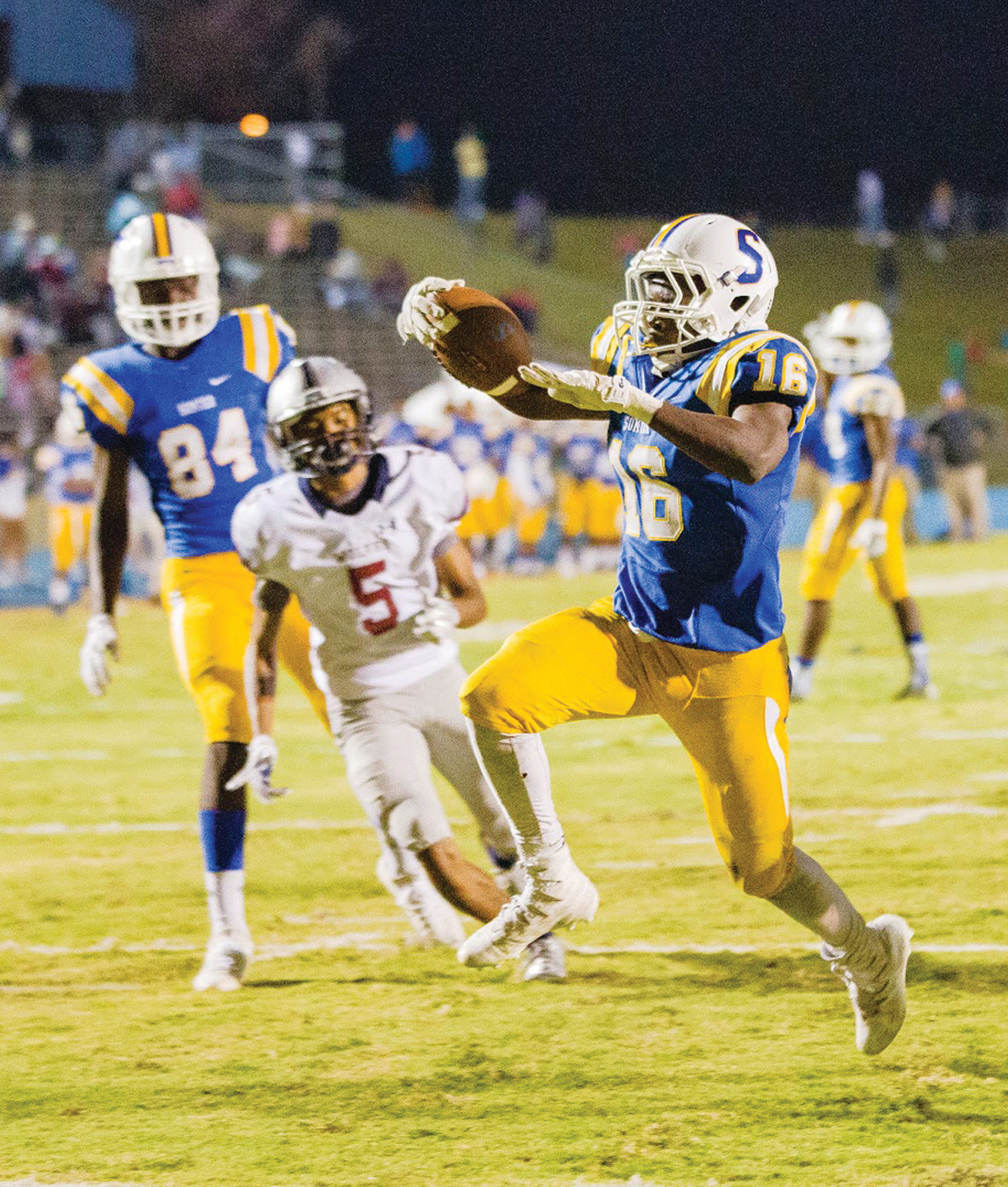 Sumter running back Jonathan Henry (16) scores a touchdown during the Gamecocks' 35-7 victory over White Knoll in the opening round of the 5A state playoffs on Friday at Memorial Stadium. Henry rushed for 203 yards and two touchdowns.