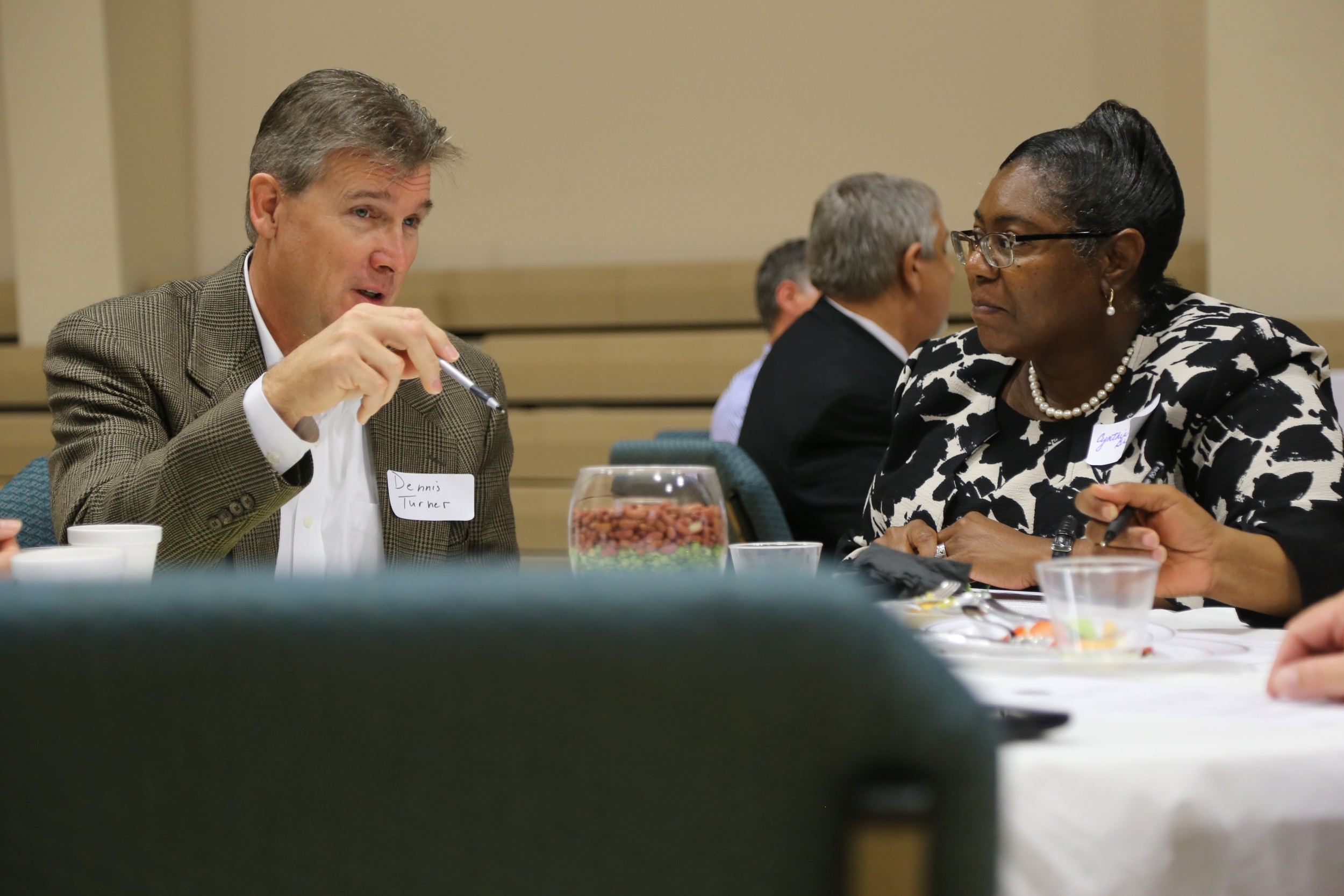 Dennis Turner, left, chairman of the Greater Sumter Chamber of Commerce's Education Committee, talks with Cynthia Graham, Sumter School District's director of literacy programs, on Friday at the Leaders for Learning Partnership Breakfast.