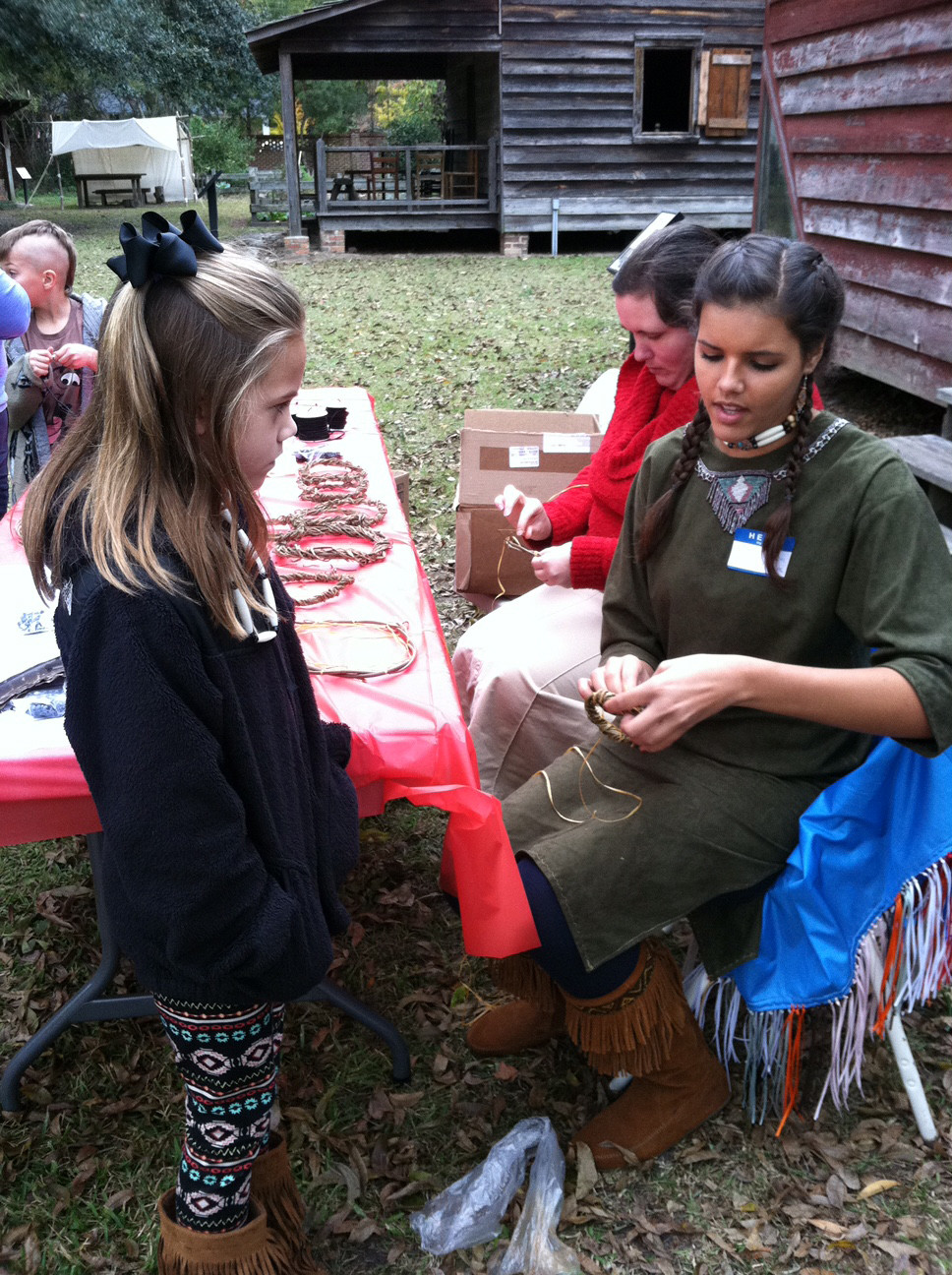 Karli Hudson helps a child make a dream catcher at a previous tribe event. This year's Sumter Native American Festival will be held from 11 a.m. to 3 p.m. at the Sumter County Museum, 122 N. Washington St.