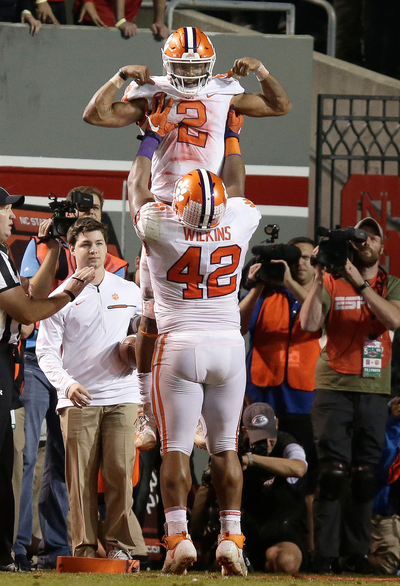 THE ASSOCIATED PRESSClemson's Christian Wilkins (42) lifts quarterback Kelly Bryant (2) in celebration after Bryant's touchdown run in the second half of the Tigers' 38-31 victory over North Carolina State on Saturday in Raleigh.