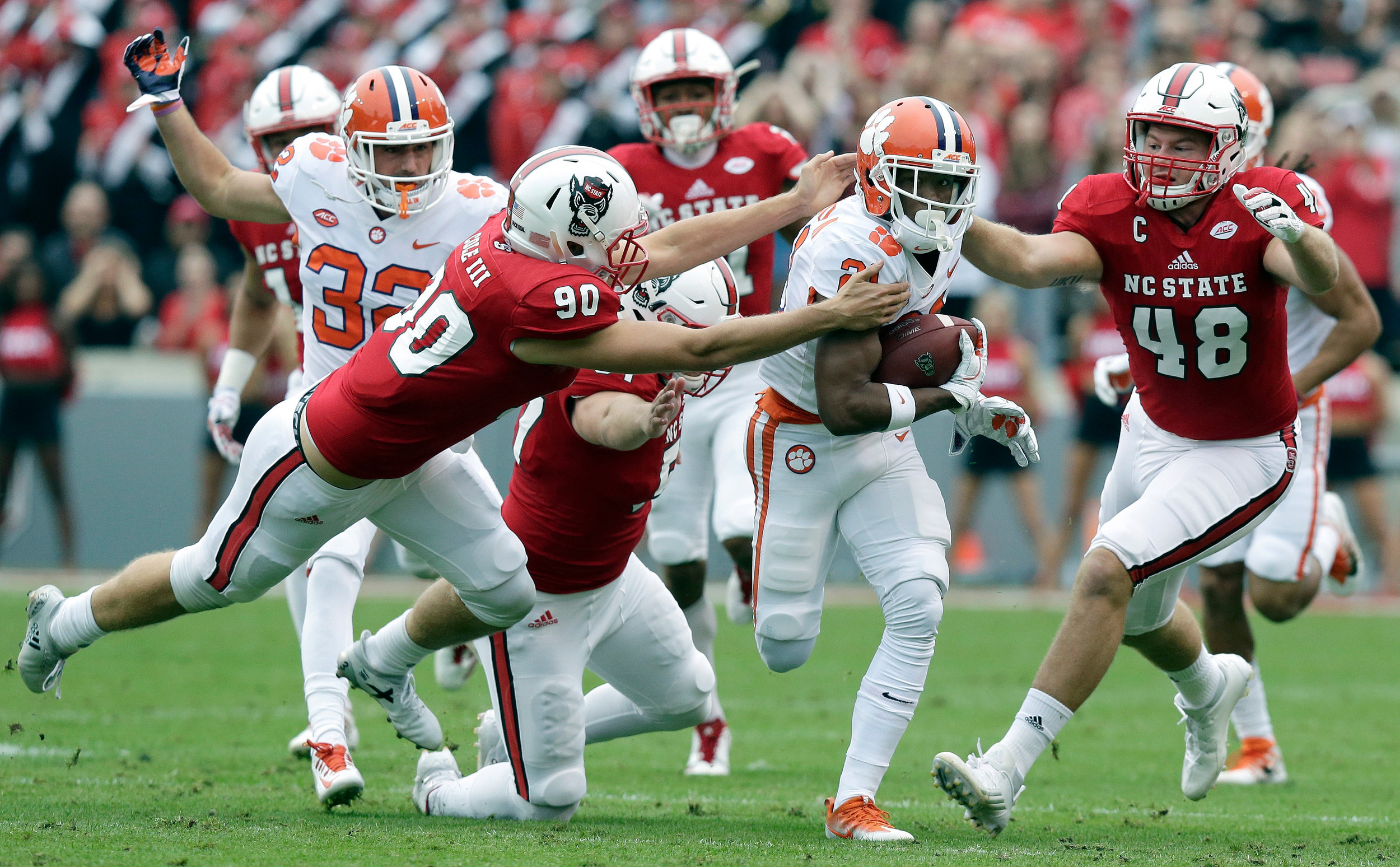 THE ASSOCIATED PRESSClemson's Ray-Ray McCloud runs past North Carolina State's Ben Frazier (90) and Cole Cook (48) on the way to a touchdown in the Tigers' 38-31 victory on Saturday in Raleigh.