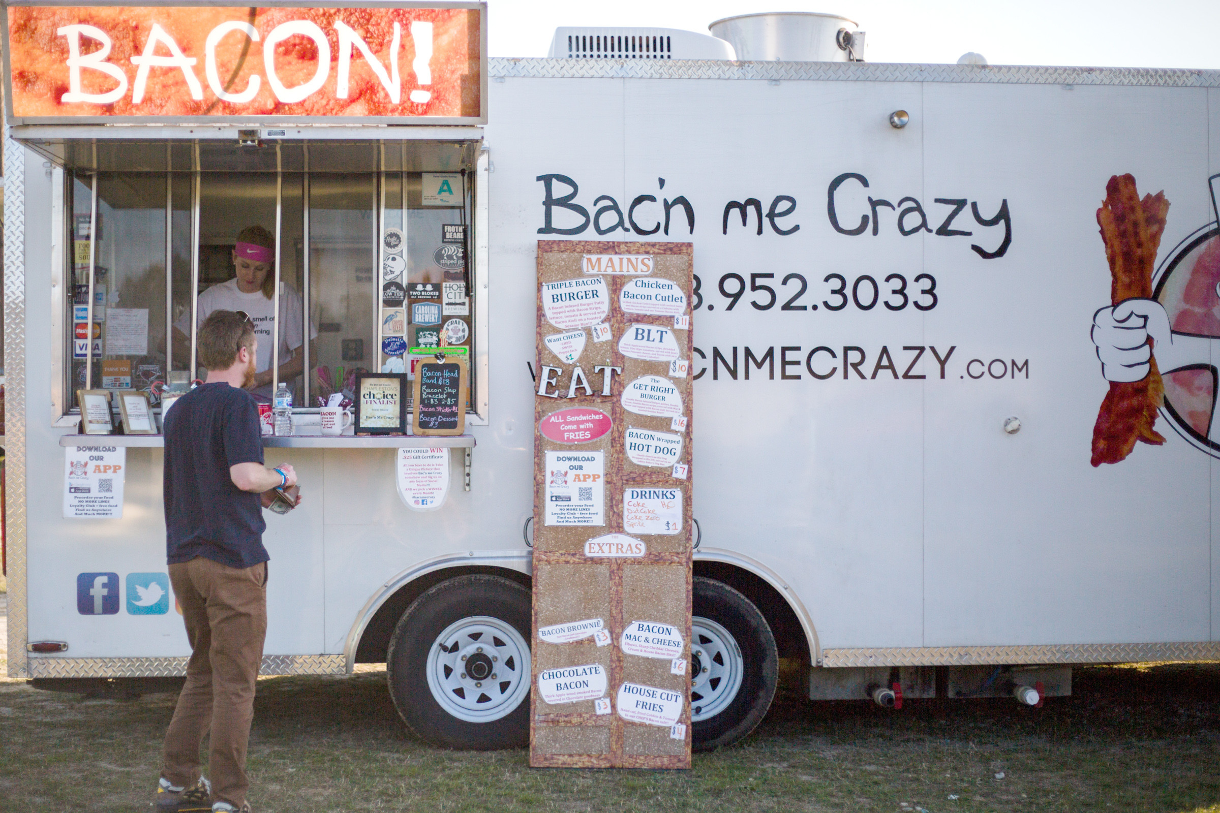 Coleman Brock checks out the menu at Bac'n me Crazy at a past Untapped: Food Trucks and Craft Beer Festival in Sumter.
